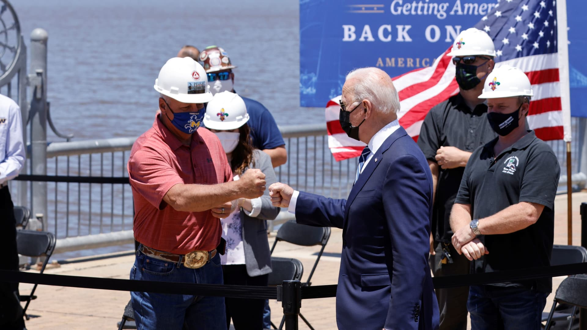 President Joe Biden bumps fist with a man before delivering remarks on his American Jobs Plan near the Calcasieu River Bridge in Lake Charles, Louisiana, U.S., May 6, 2021.