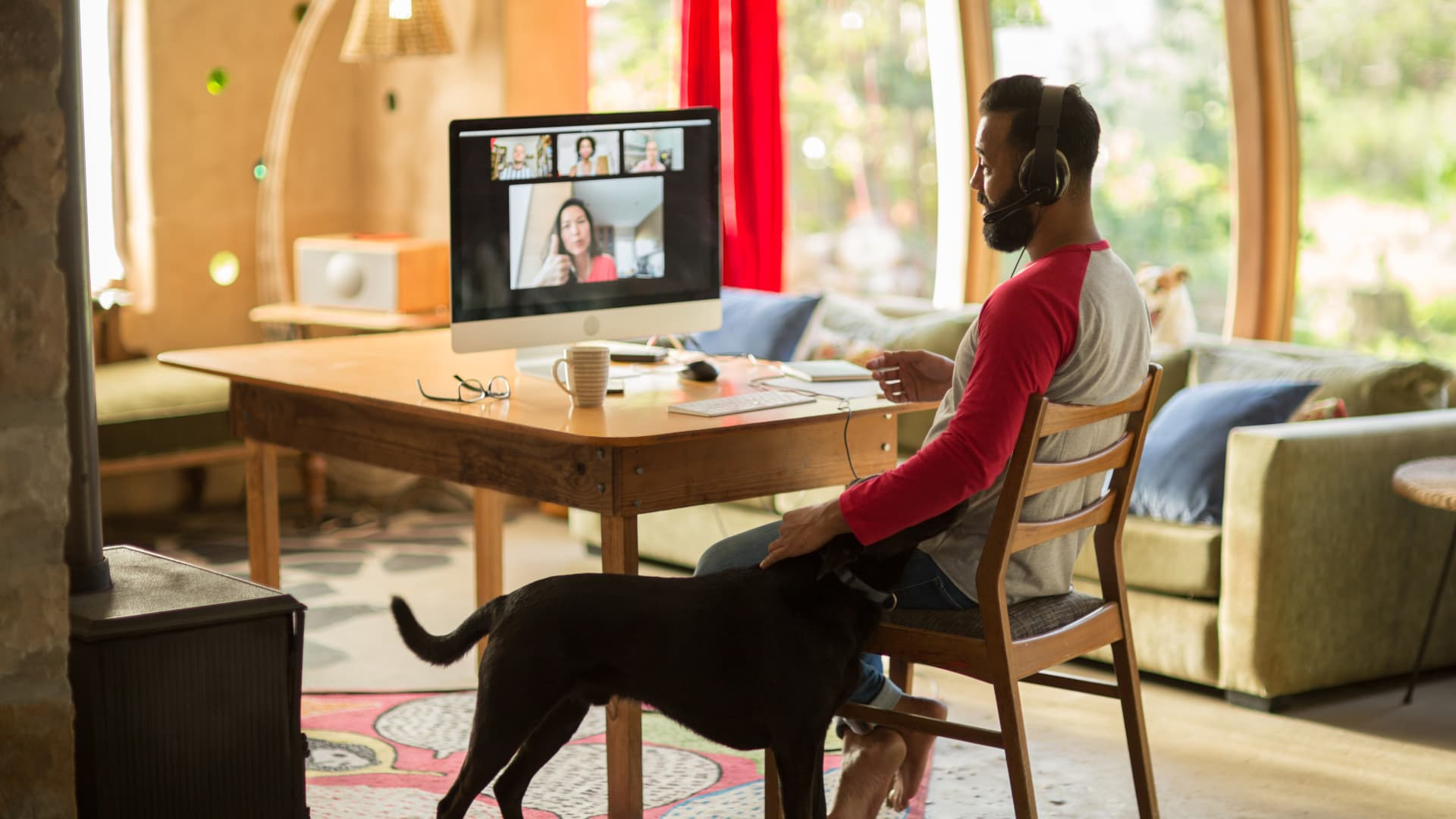 Use video chat to ask for an annual period of remote work to gauge your employer's body language, advises career coach Amanda Augustine.