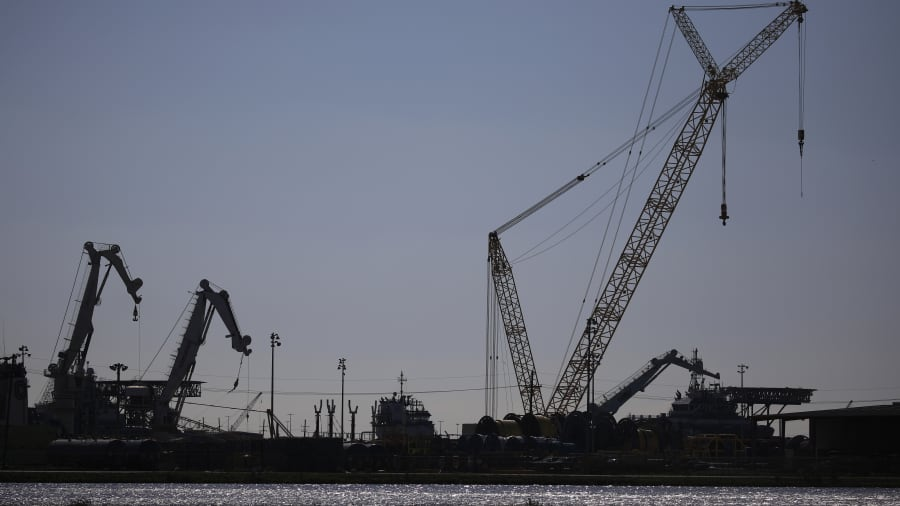 Cranes at an oil industry support facility in Port Fourchon, Louisiana, U.S., on Wednesday, April 21, 2021.