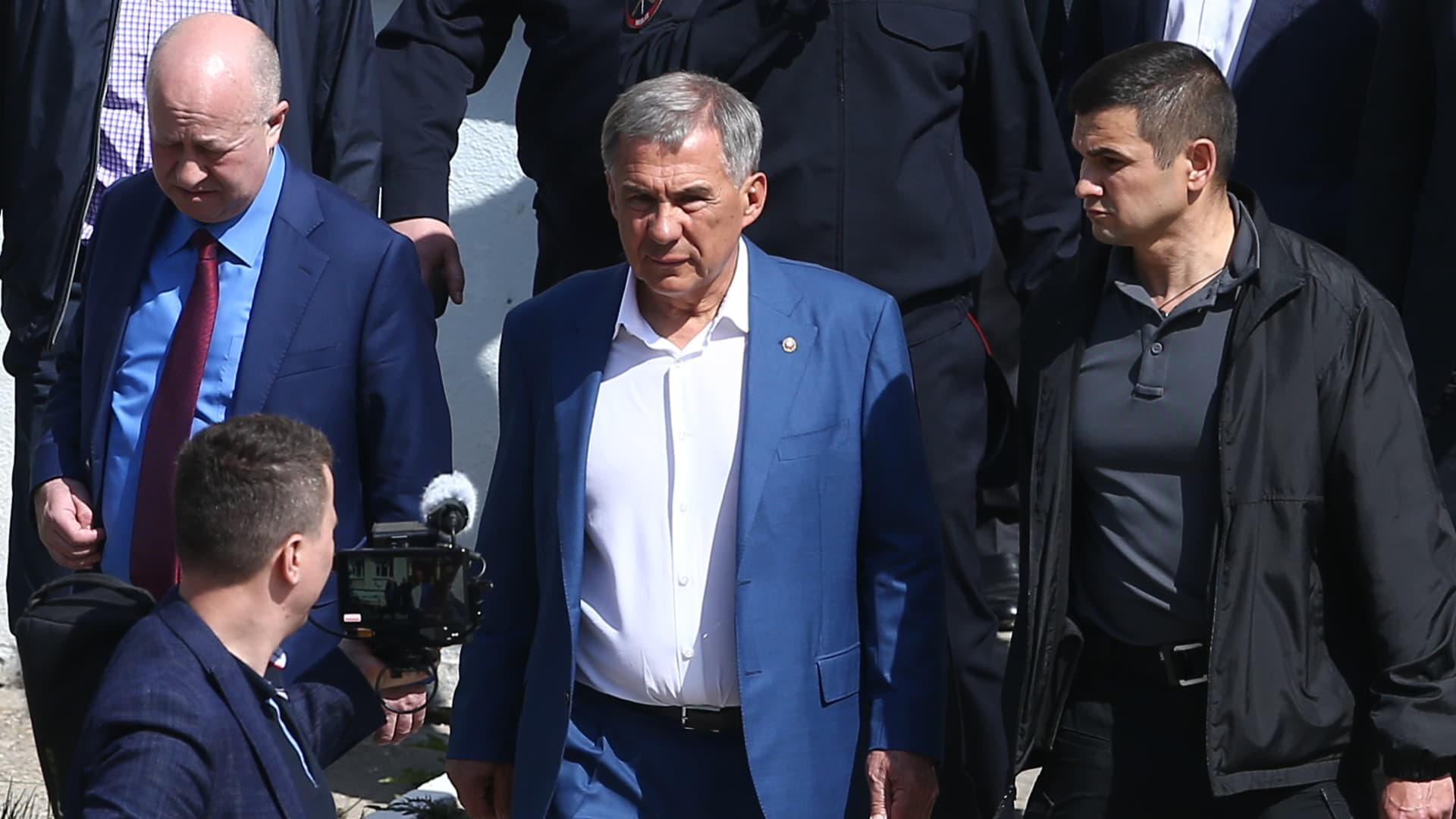 Rustam Minnikhanov, president of the Republic of Tatarstan, arrives at school No 175 where a shooting ha taken place; the number of dead is uncertain.
