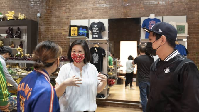 Joanne Kwong, president of Pearl River Mart, talks with customers at the business' newest location in Soho, New York City.
