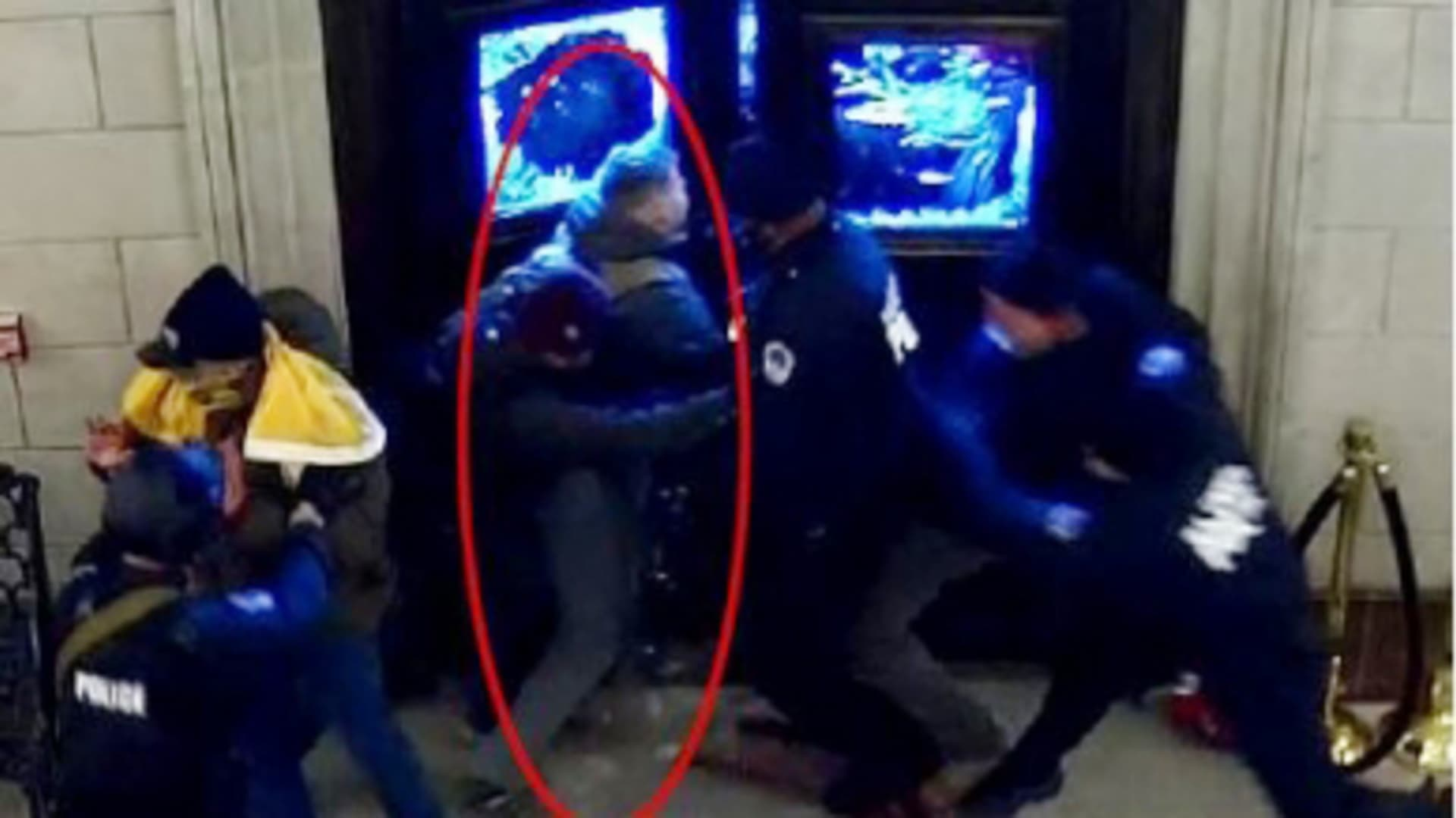 A still from a video released by the D.O.J. showing Christopher Warnagiris (circled in red), who is a Marine Corps commissioned officer stationed at the Marine Corps Base Quantico was arrested today in Virginia and charged with crimes related to the breach of the U.S. Capitol on Jan. 6.