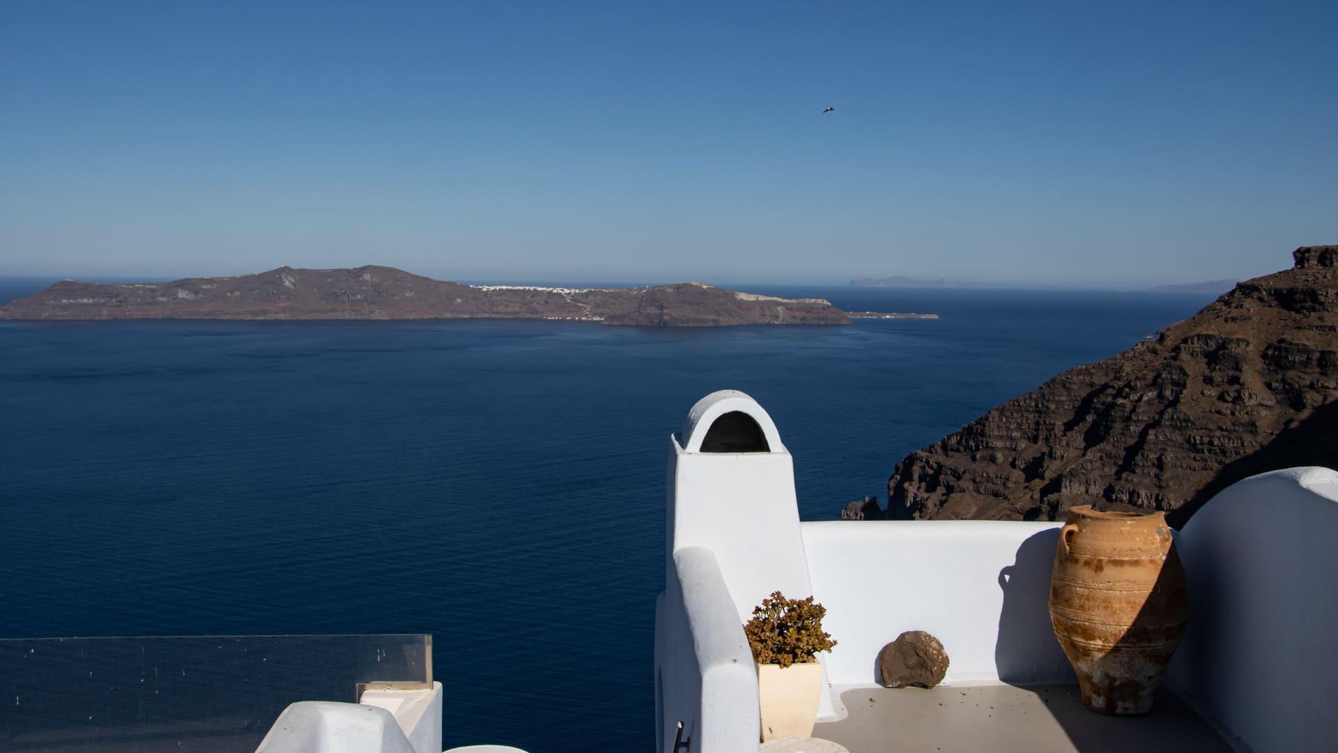 Panoramic view of Thera and Imerovigli of Santorini Volcanic Island in Cyclades - Aegean sea.