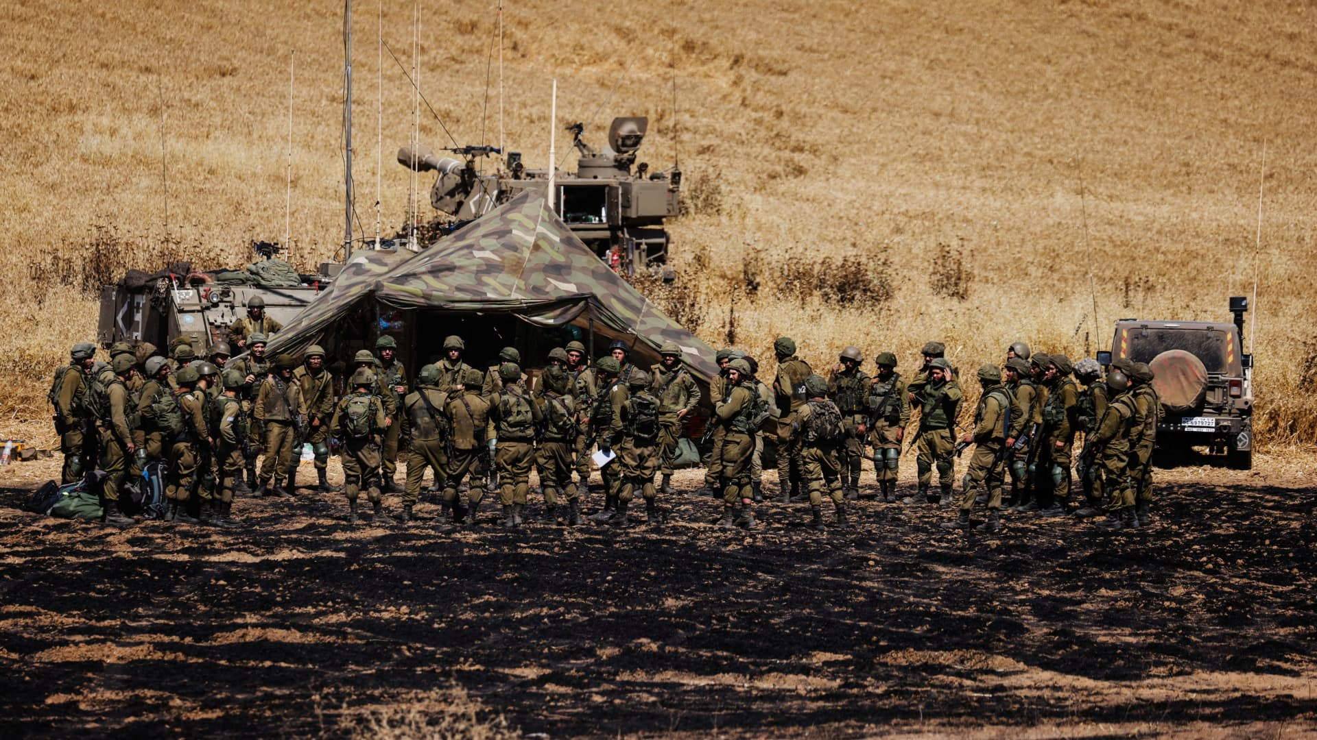 Israeli soldiers of an artillery unit gather near the border between Israel and the Gaza Strip, on its Israeli side May 14, 2021.