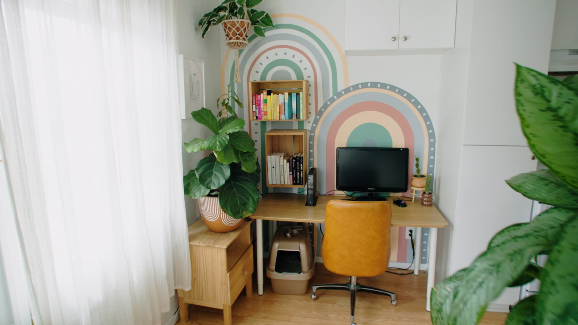 To save money, Hinds buys smaller paint samples to create murals on her walls.