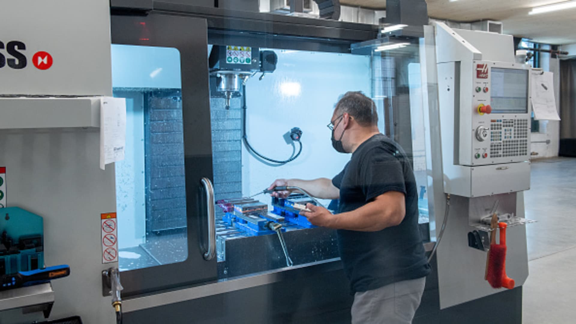 A CNC operator produces components at the Nanotronics lab as Mayor Bill De Blasio welcomes Nanotronics high-tech manufacturing hub to Brooklyn Navy Yard on April 28, 2021 in New York City.