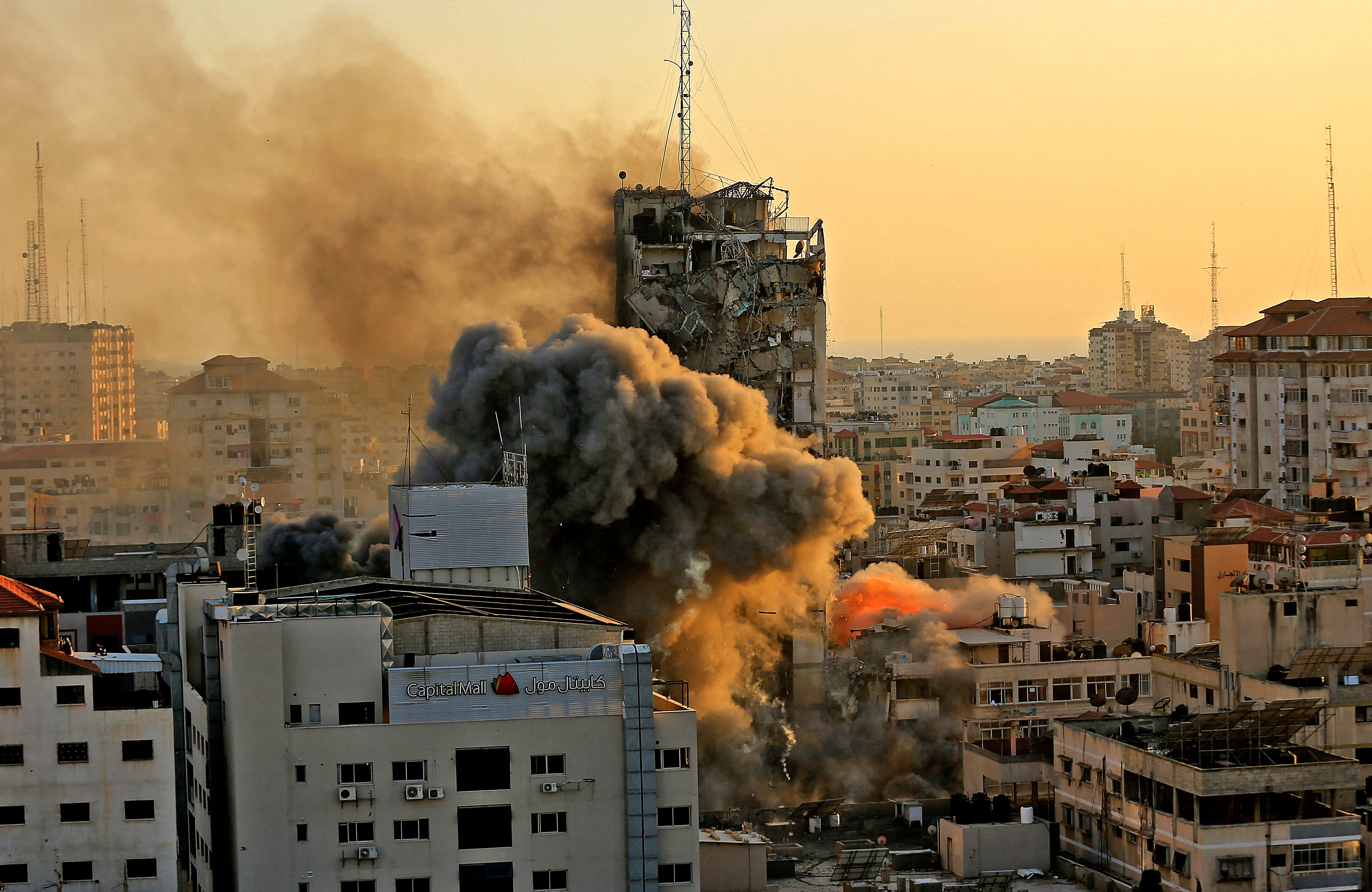 Gaza tower housing AP, Al Jazeera collapses after missile strike