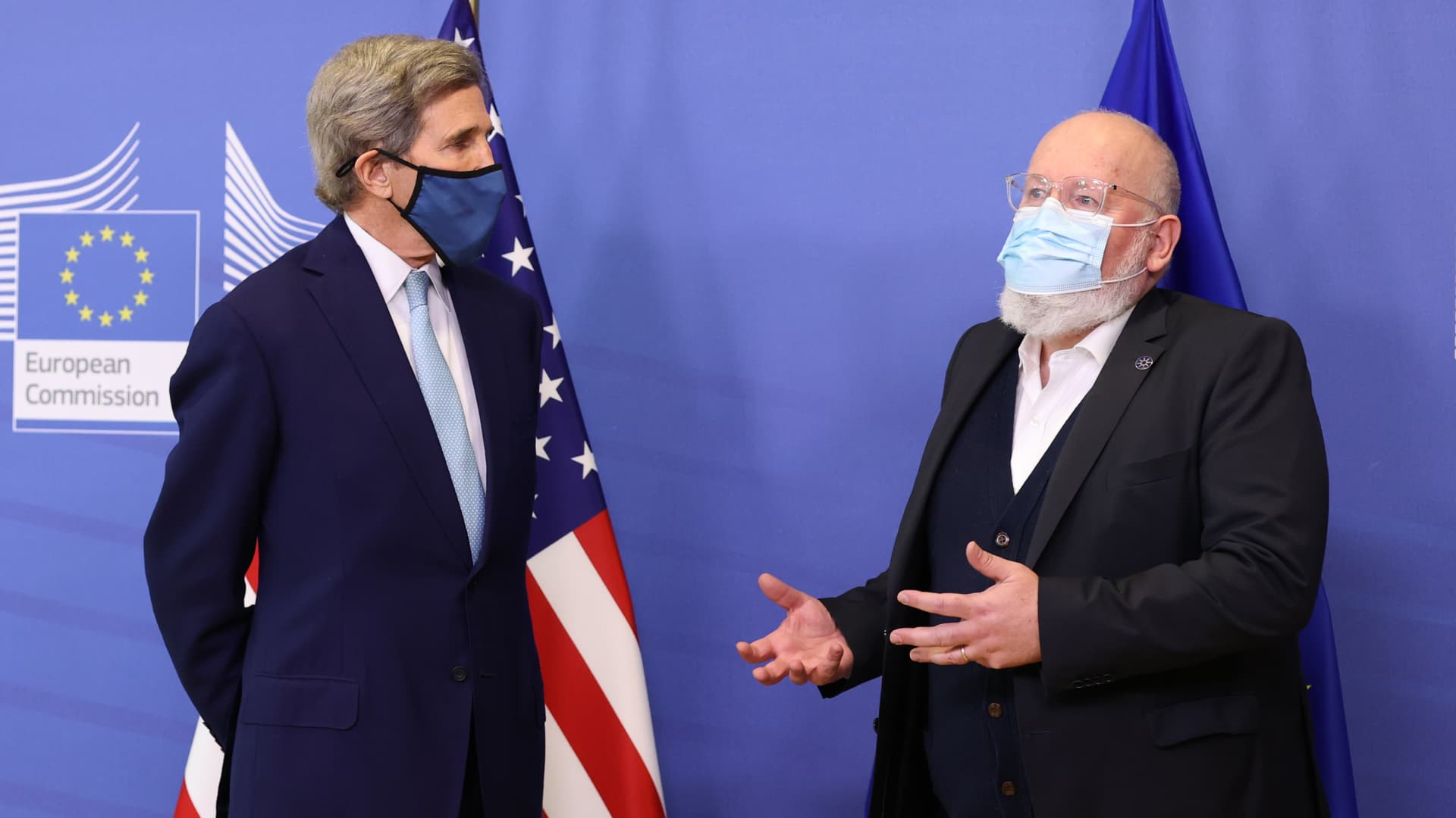 U.S. Special Presidential Envoy for Climate John Kerry (L) and European Commission vice-president in charge for European green deal Frans Timmermans (R) give a joint news conference in Brussels, Belgium on March 9, 2021.
