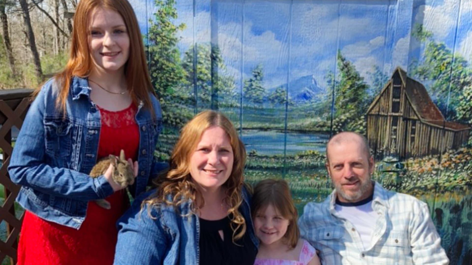 Sarah Rush, her daughters, Kylee, 15, and Adalyn, 6, and her husband Tim, 48.