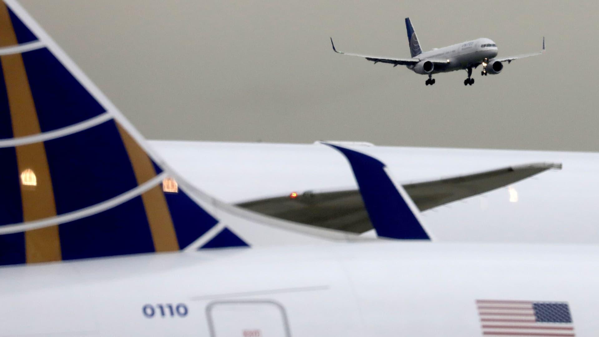 A United Airlines passenger jet lands at Newark Liberty International Airport, New Jersey, U.S. December 6, 2019.