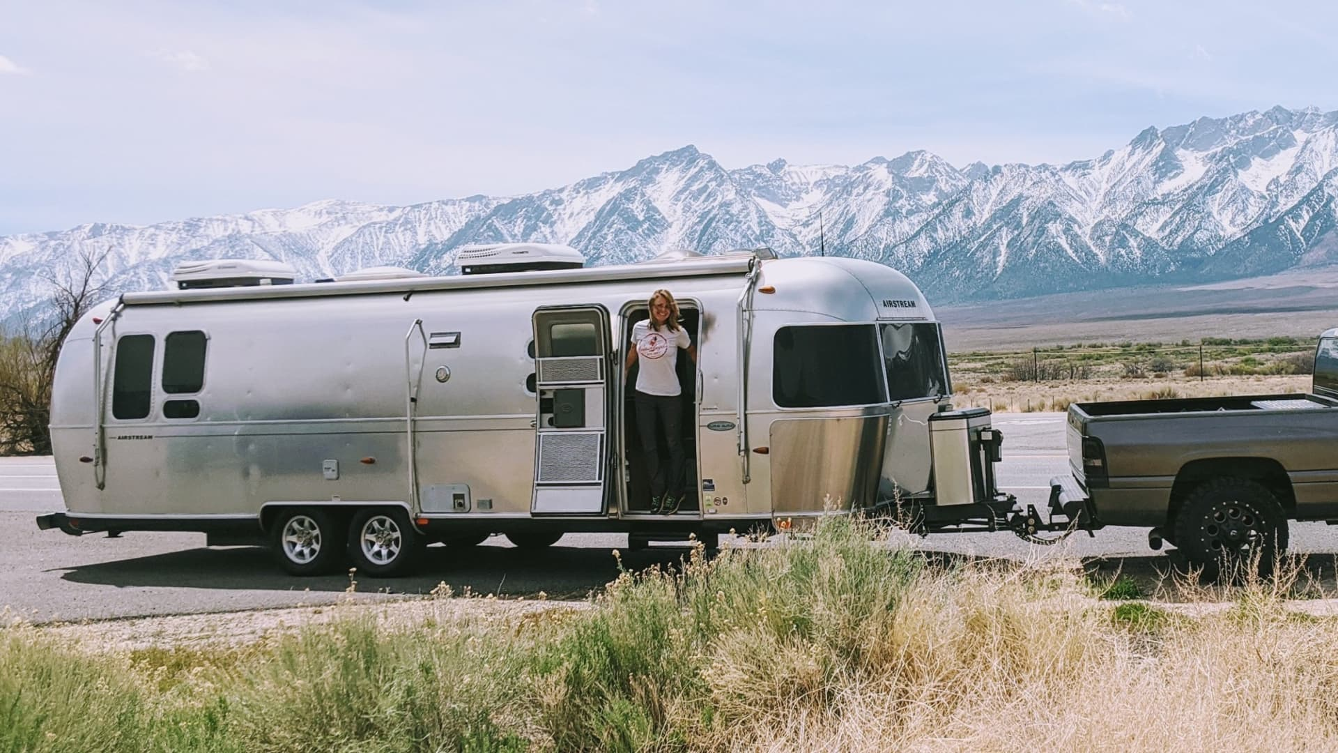 Kelli Compton, 35, stands in her Airstream RV in Wyoming.