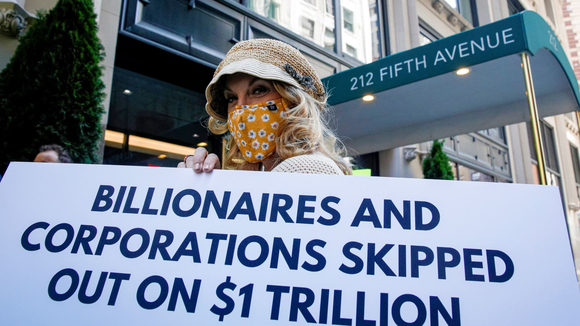 Members of the Patriotic Millionaires hold a federal tax filing day protest outside the apartment of Amazon founder Jeff Bezos, to demand he pay his fair share of taxes, in New York City, May 17, 2021.