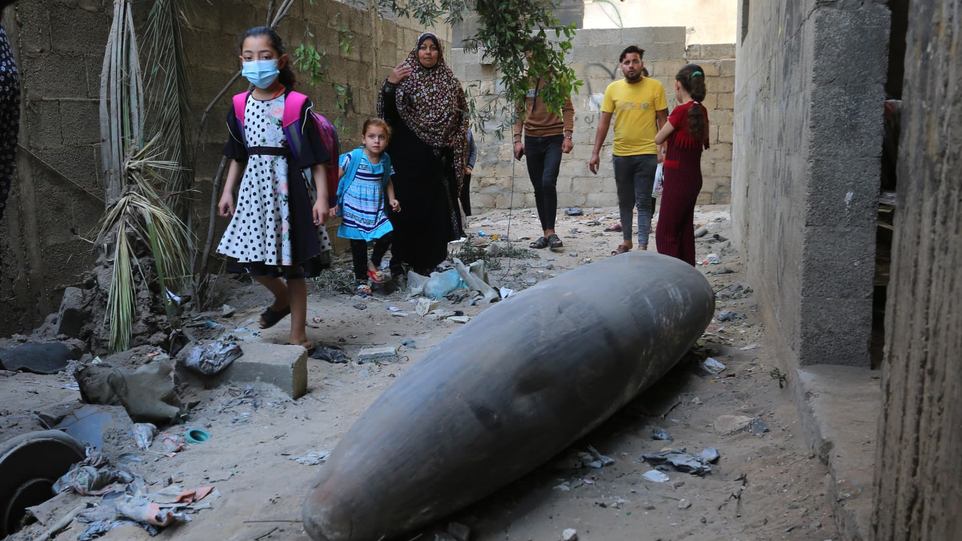 People look at an unexploded missile thrown by Israel in al-Rimal neighborhood as Israeli warplanes continue to carry out airstrikes in Gaza City, Gaza on May 18, 2021.