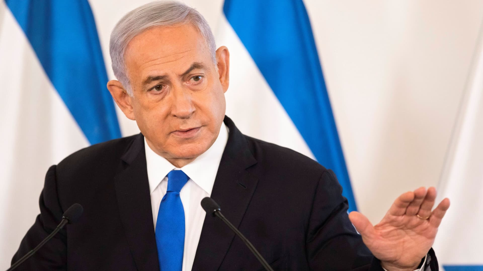 Israeli Prime Minister Benjamin Netanyahu gestures as he speaks during a briefing to ambassadors to Israel at a military base in Tel Aviv, Israel May 19, 2021.
