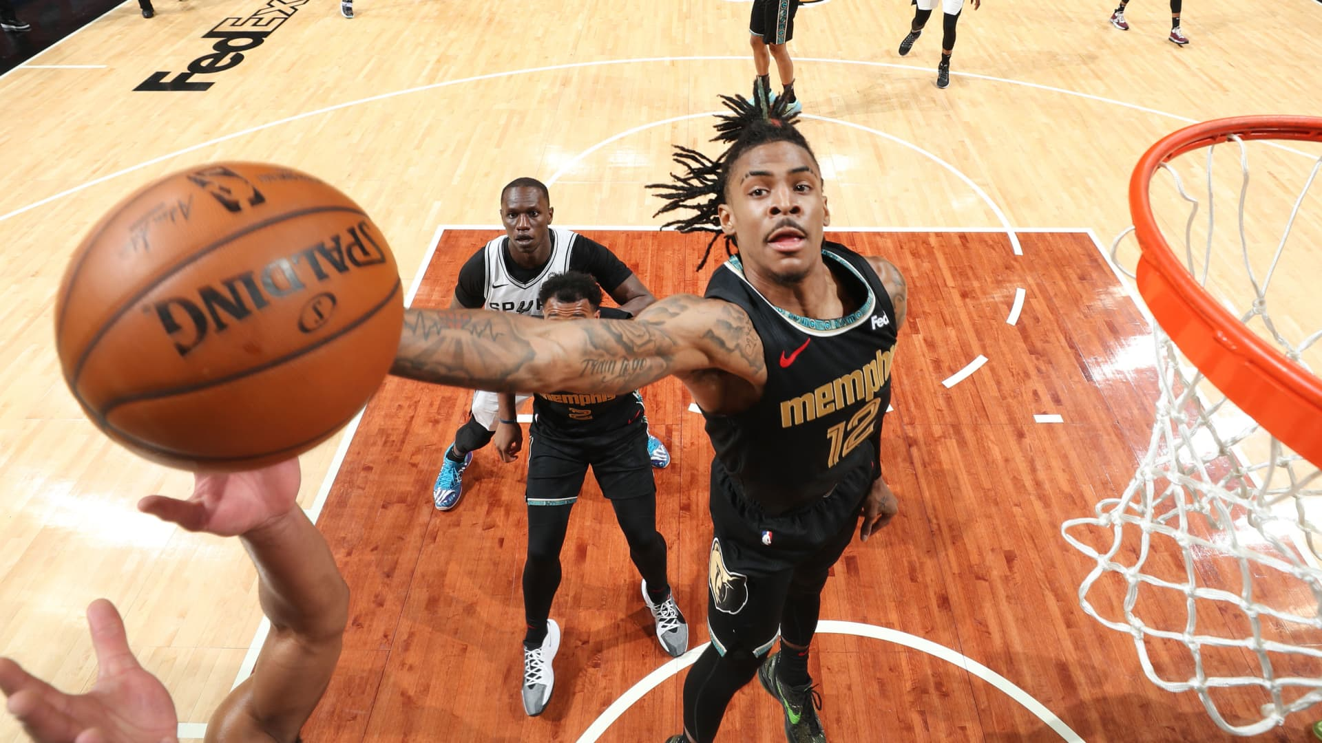 Ja Morant #12 of the Memphis Grizzlies rebounds the ball against the San Antonio Spurs during the 2021 NBA Play-In Tournament on May 19, 2021 at FedExForum in Memphis, Tennessee.