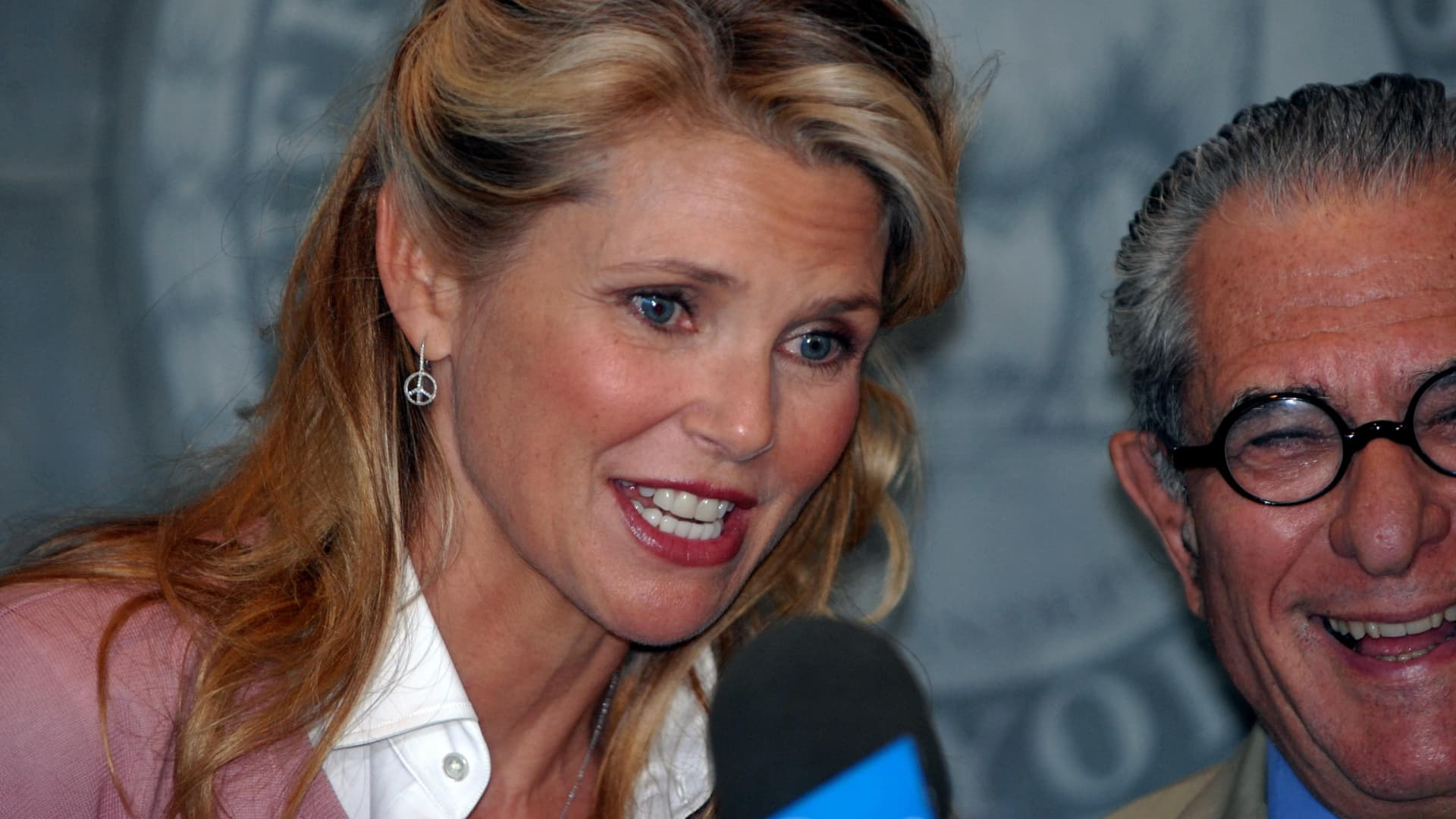 Central Islip, N.Y.: Christie Brinkley and attorney Robert Cohen, after reaching a settlement in the divorce trial with Peter Cook, speak with the media during news conference at the courthouse in Central Islip, New York on July 10, 2008.