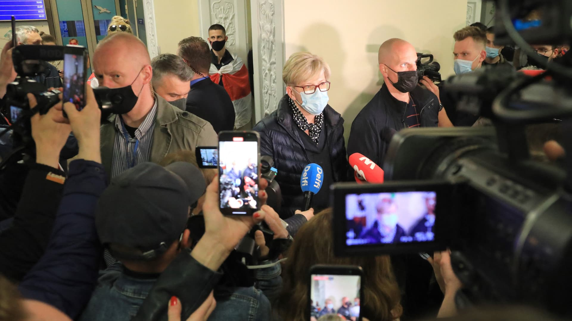Lithuanian Prime Minister Ingrida Simonyte (C) speaks to journalists at Vilnius International Airport on May 23, 2021, following the landing of the Ryanair passenger plane.