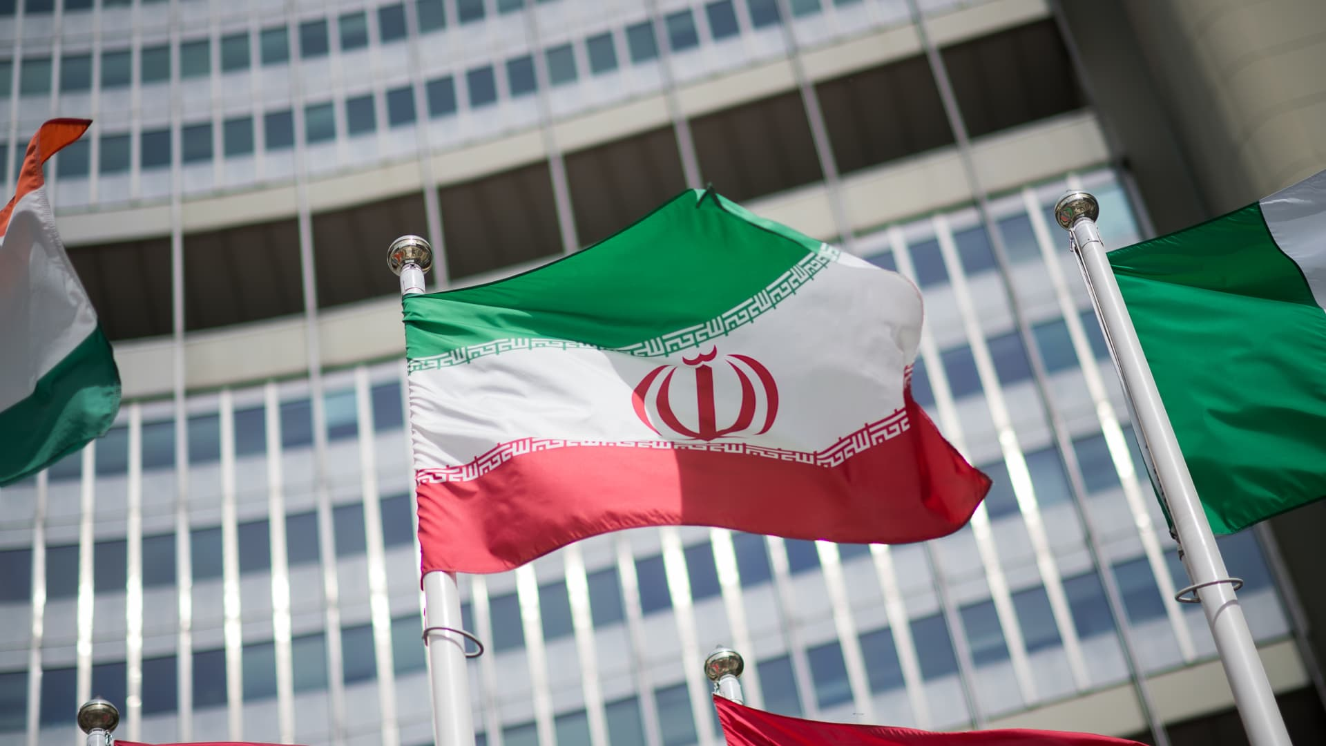 The flag of Iran is seen in front of the building of the International Atomic Energy Agency (IAEA) Headquarters ahead of a press conference by Rafael Grossi, Director General of the IAEA, about the agency's monitoring of Iran's nuclear energy program on May 24, 2021 in Vienna, Austria.