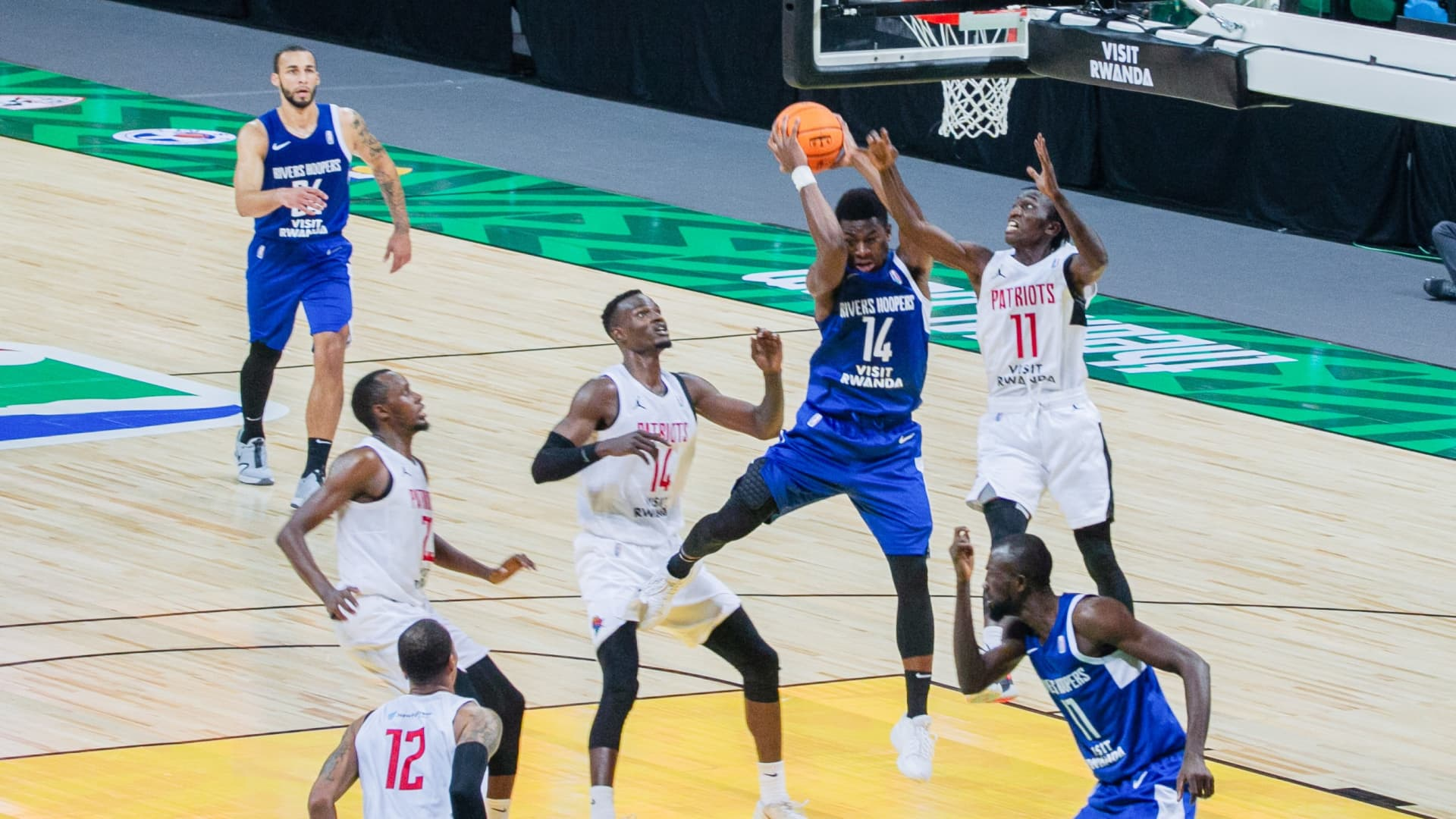 Benjamin Chukwukelo Uzoh 2nd R of Rivers Hoopers of Nigeria vies with Wilson Nshobozwa of Patriots Rwanda during the opening game of the the inaugural Basketball Africa League BAL in Kigali, capital city of Rwanda, May 16, 2021.