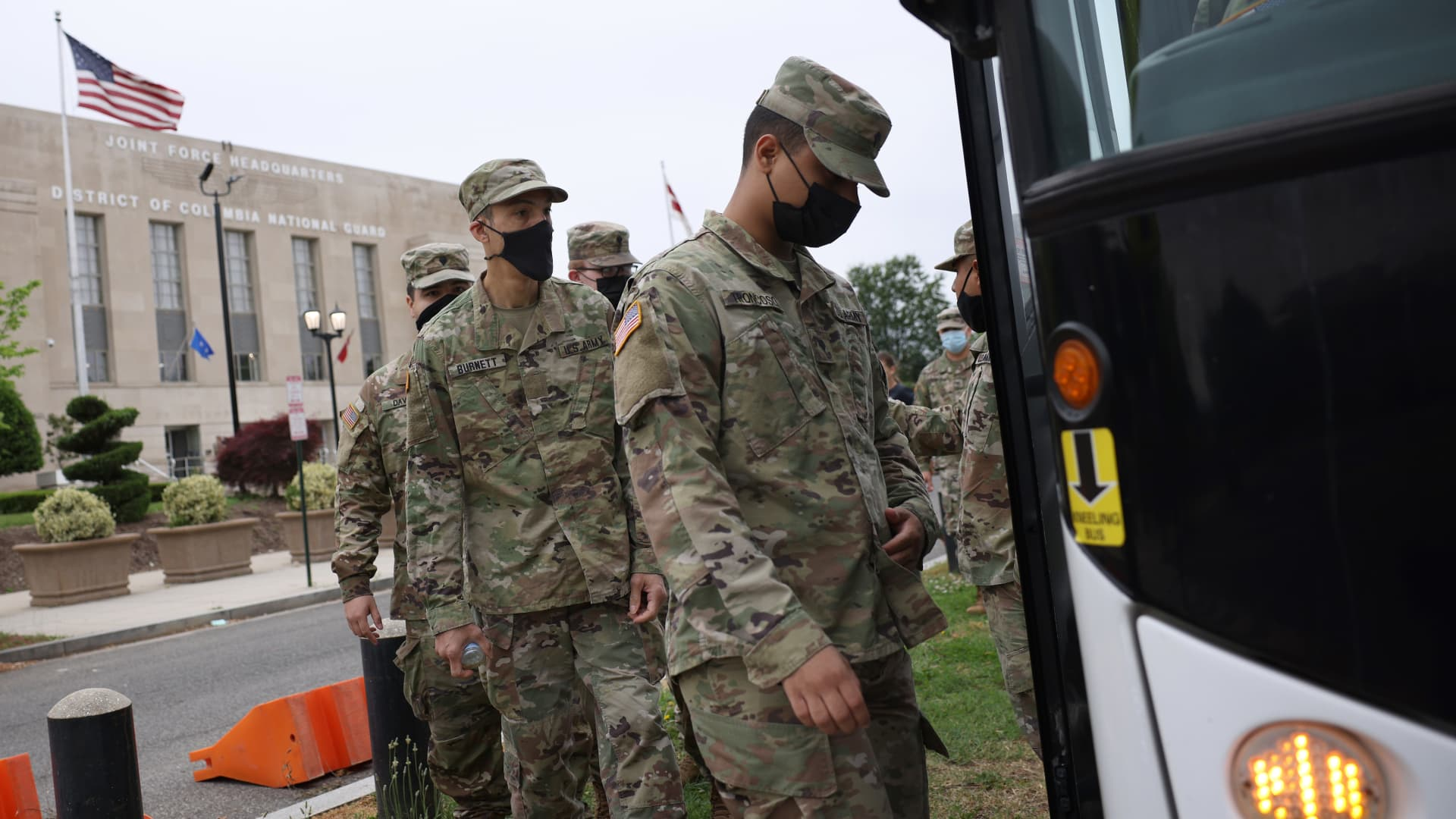 National Guard troops board buses as they leave the Armory after ending their mission of providing security to the U.S. Capitol on May 24, 2021 in Washington, DC.