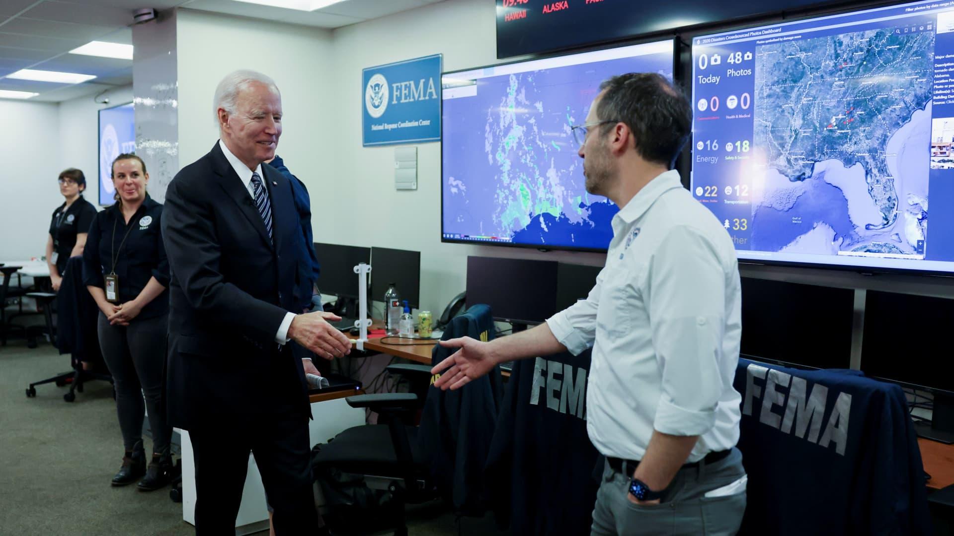 U.S. President Joe Biden greets Federal Emergency Management Agency (FEMA) staff as he visits its headquarters to receive a briefing on the Atlantic hurricane season, in Washington, May 24, 2021.