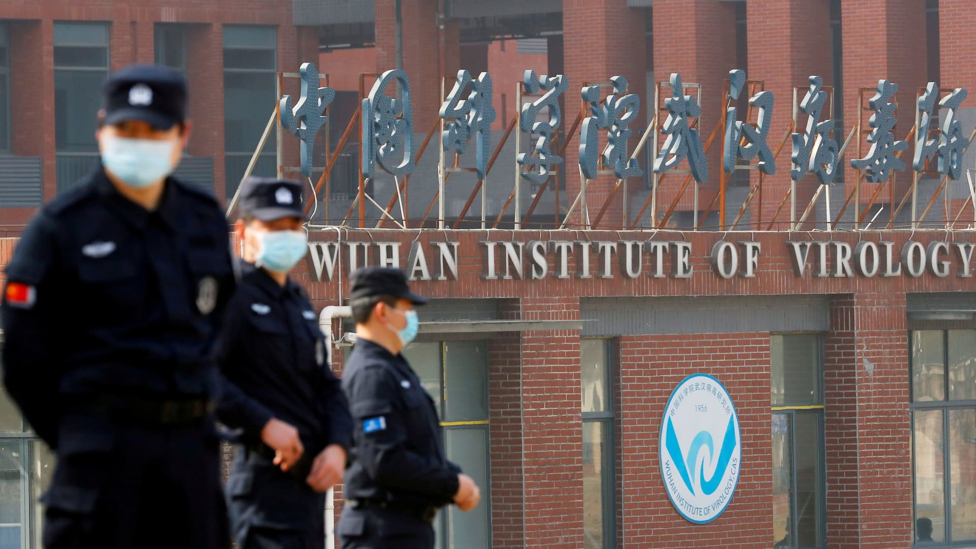 Security personnel keep watch outside the Wuhan Institute of Virology during the visit by the World Health Organization (WHO) team tasked with investigating the origins of the coronavirus disease (COVID-19), in Wuhan, Hubei province, China February 3, 2021.
