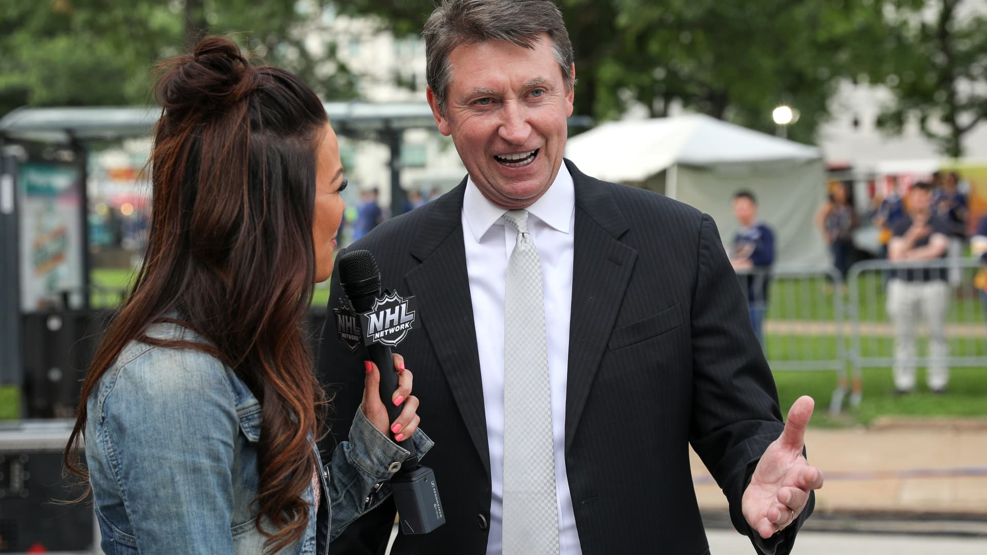 Jamie Redmond interviews Wayne Gretzky before Game Four of the 2019 NHL Stanley Cup Final between the Boston Bruins and the St. Louis Blues at Enterprise Center on June 03, 2019 in St Louis, Missouri.
