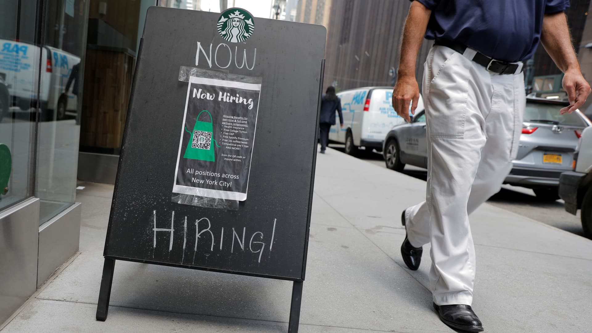 A sign advertising job openings is seen outside of a Starbucks in Manhattan, New York City, New York, U.S., May 26, 2021.