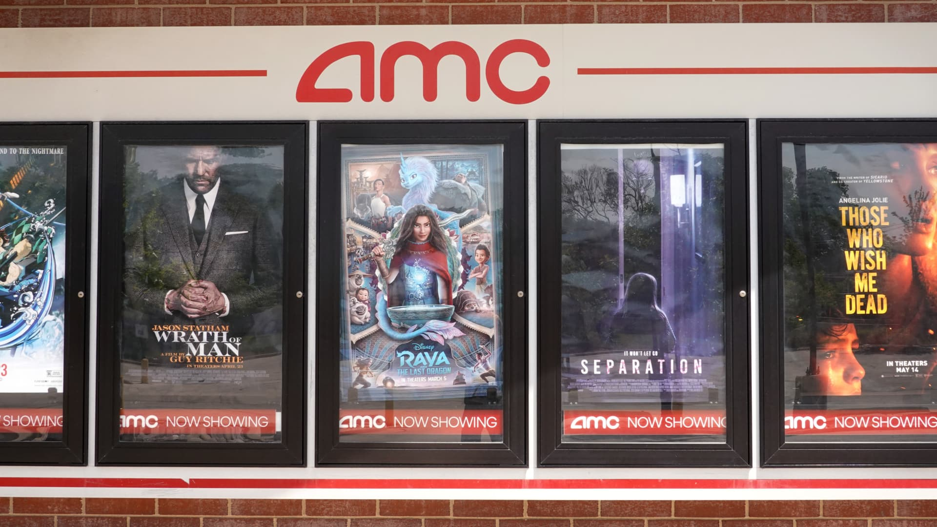 Movie poster of current offerings are displayed on the front of an AMC theater on June 01, 2021 in Chicago, Illinois. Mudrick Capital has agreed to purchase 8.5 million share of the theater chain for $230.5 million.