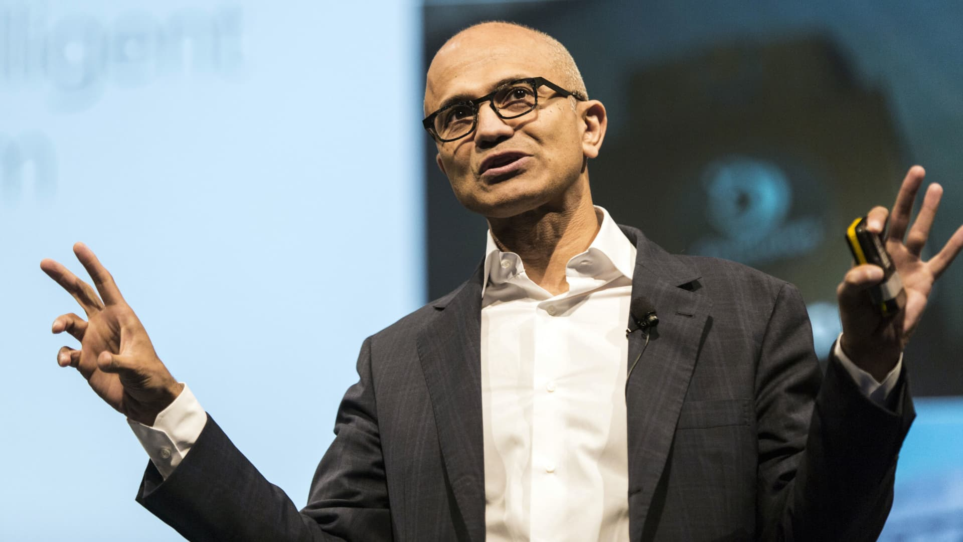 Satya Nadella, chief executive officer of Microsoft Corp., speaks during the opening keynote session at the Microsoft Developer Day in Singapore, on Friday, May 27, 2016. Microsoft has all but abandoned the smartphone game. The company said Wednesday that it will axe as many as 1,850 jobs, many of them in Finland -- home base of the handset business Microsoft acquired two years ago from Nokia Oyj.