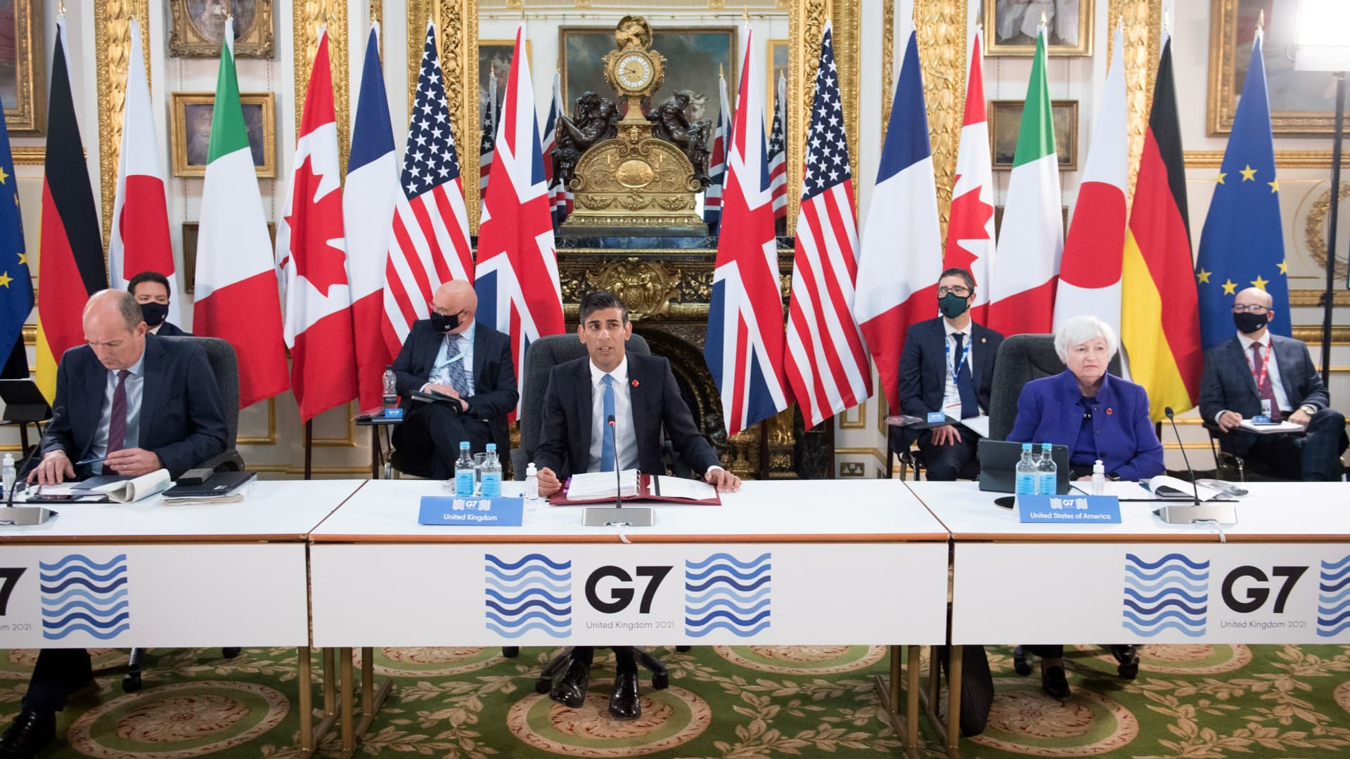 Britain's Chancellor of the Exchequer Rishi Sunak (center), U.S. Treasury Secretary Janet Yellen (right) attend the first day of the G-7 Finance Ministers Meeting at Lancaster House in London on June 4, 2021.