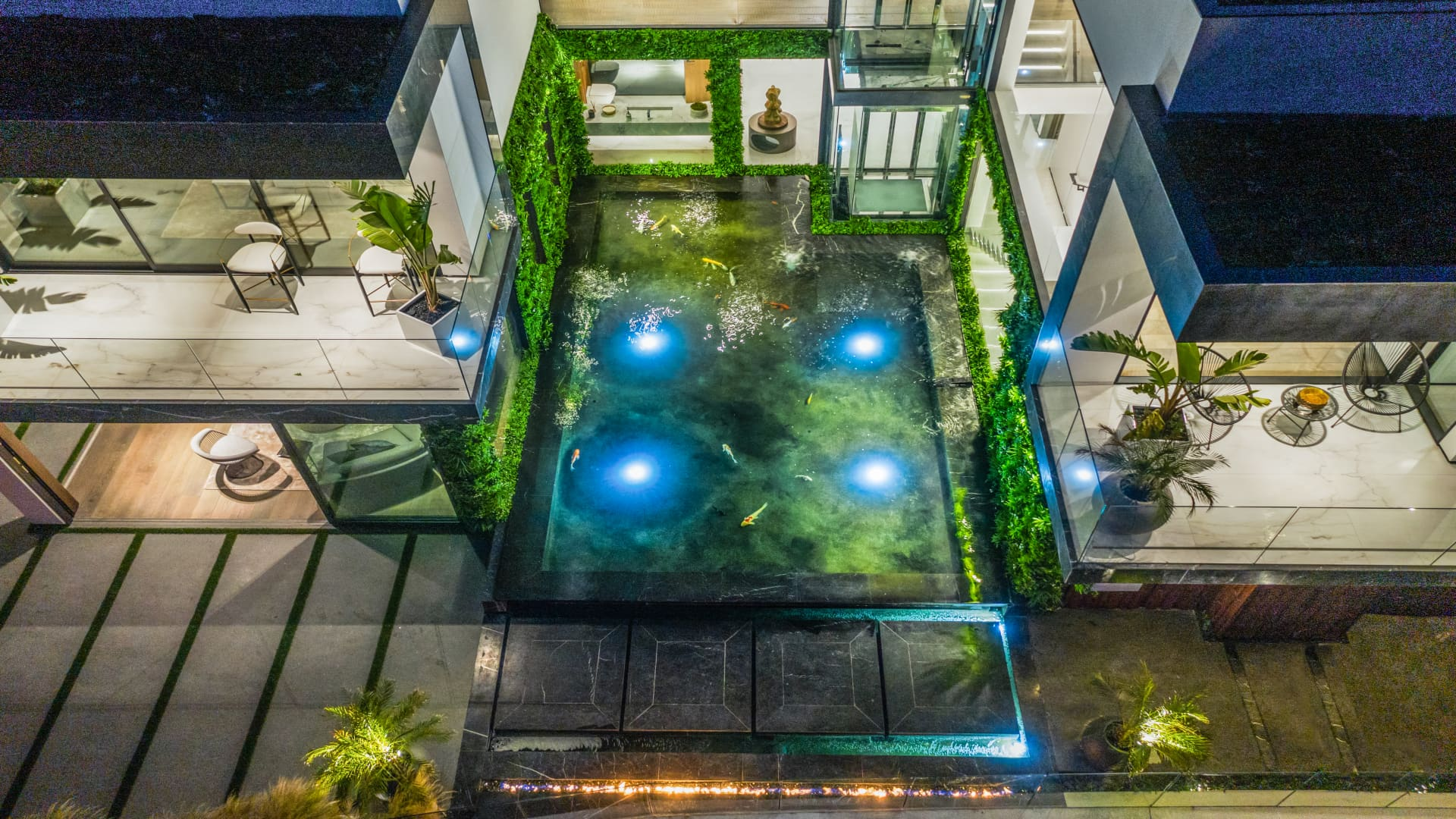 The view from above the home's outdoor koi pond.