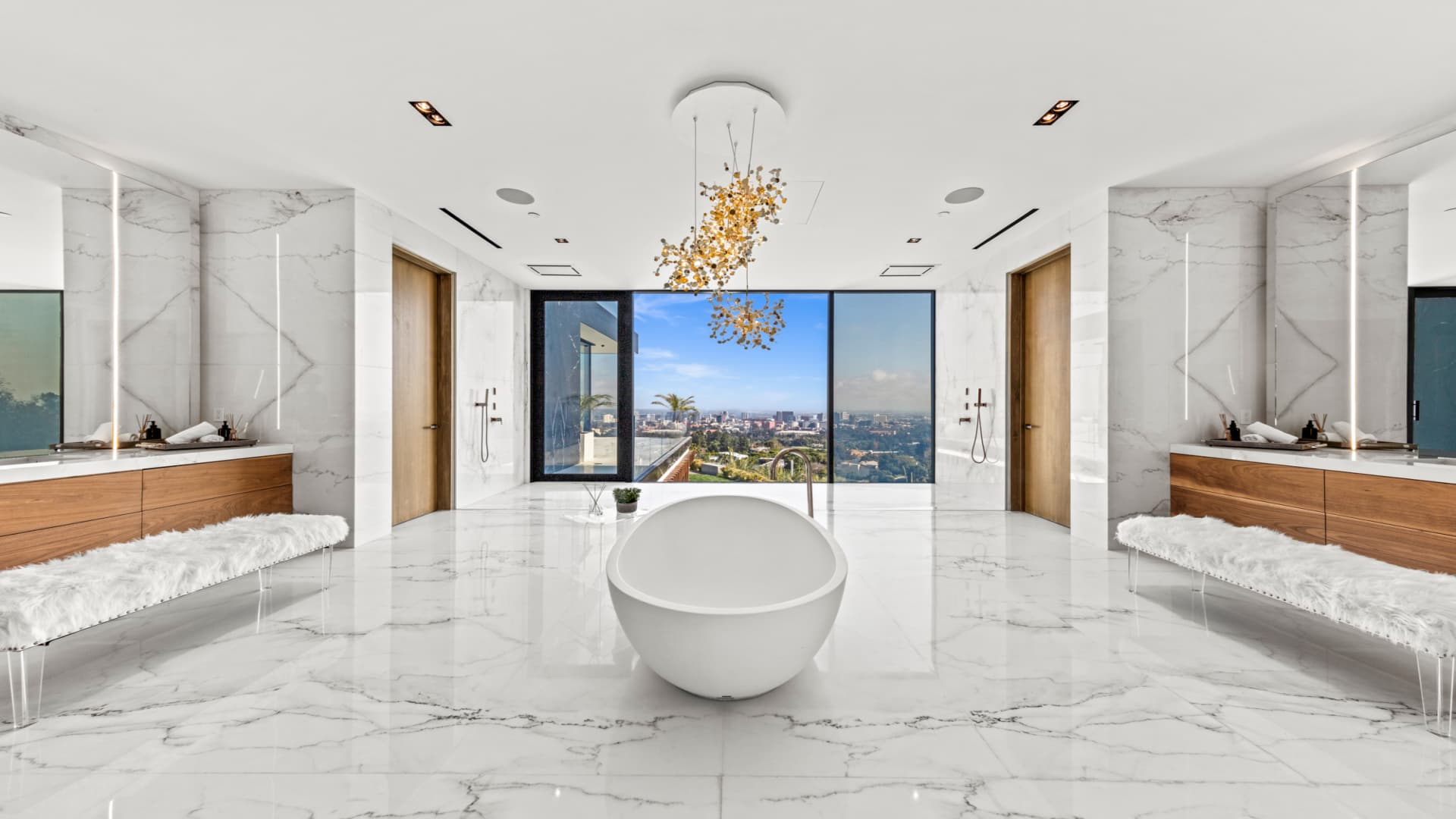 The owner's suite bath is clad in bookmatched white Carrara marble.