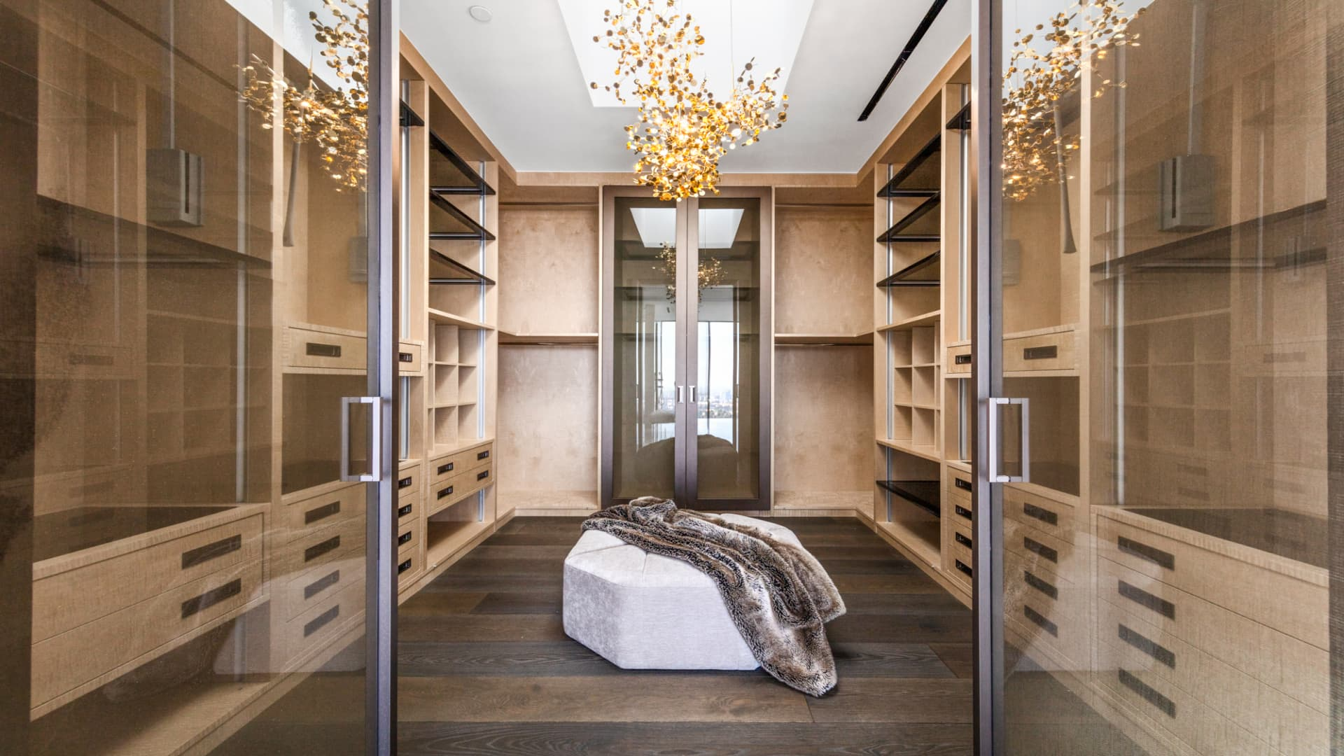 The owner's suite has two identical walk-in closets, each with a skylight and a gold chandelier.