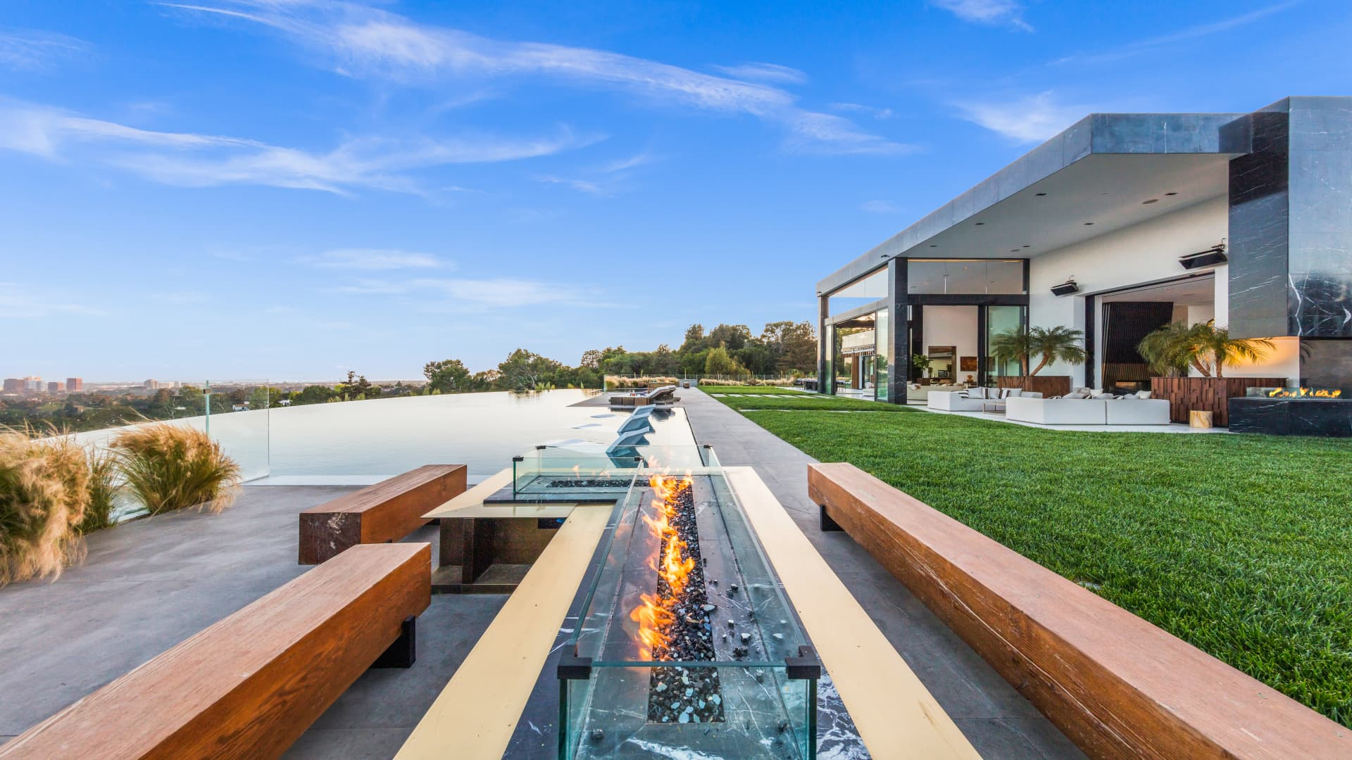 One of the outdoor seating areas is accented with fire features.