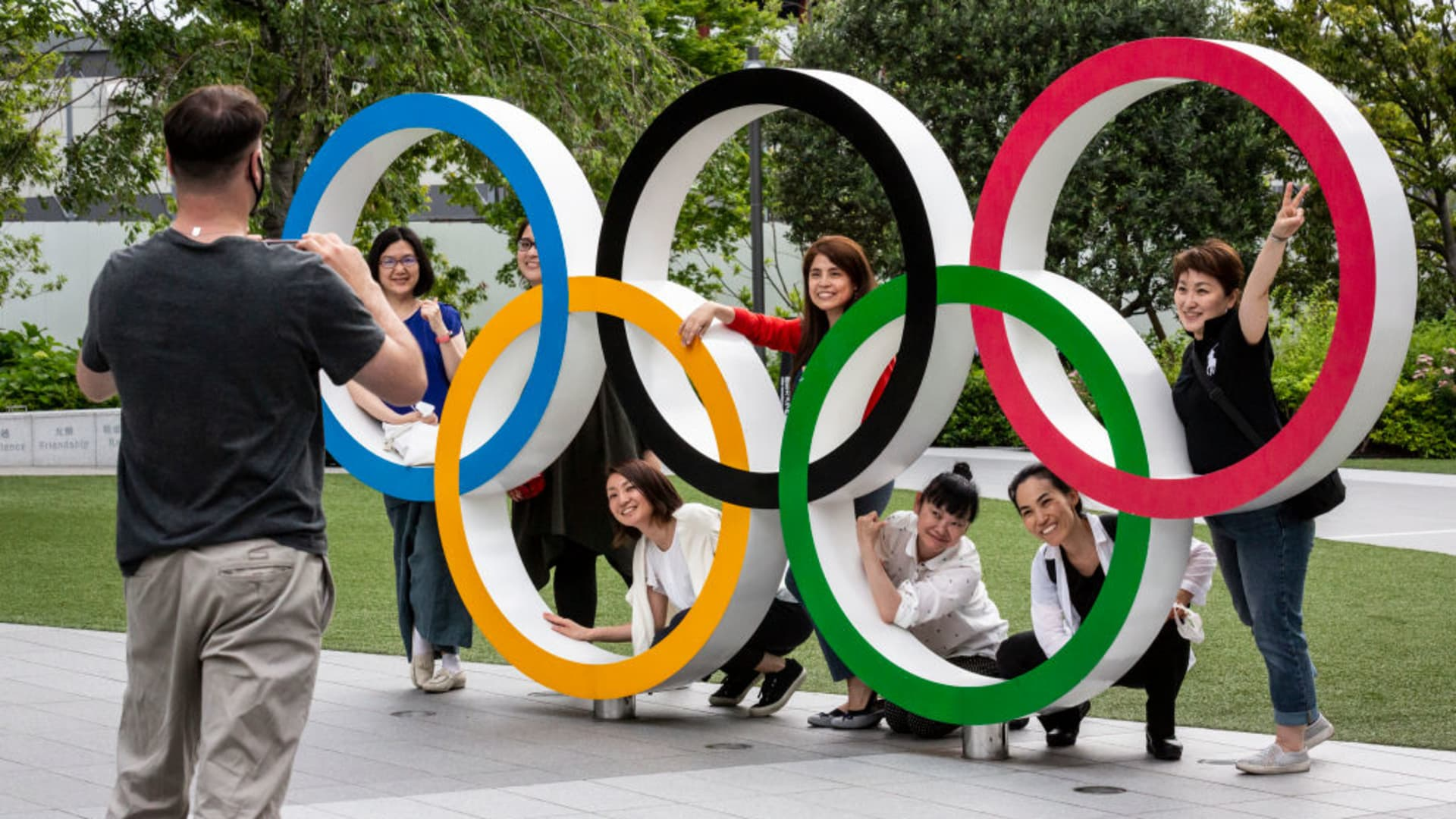 People have their photographs taken next to the Olympic Rings on June 03, 2021 in Tokyo, Japan. Tokyo 2020 president Seiko Hashimoto has stated that she is 100 percent certain that the Olympics will go ahead despite widespread public opposition as Japan grapples with a fourth wave of coronavirus.