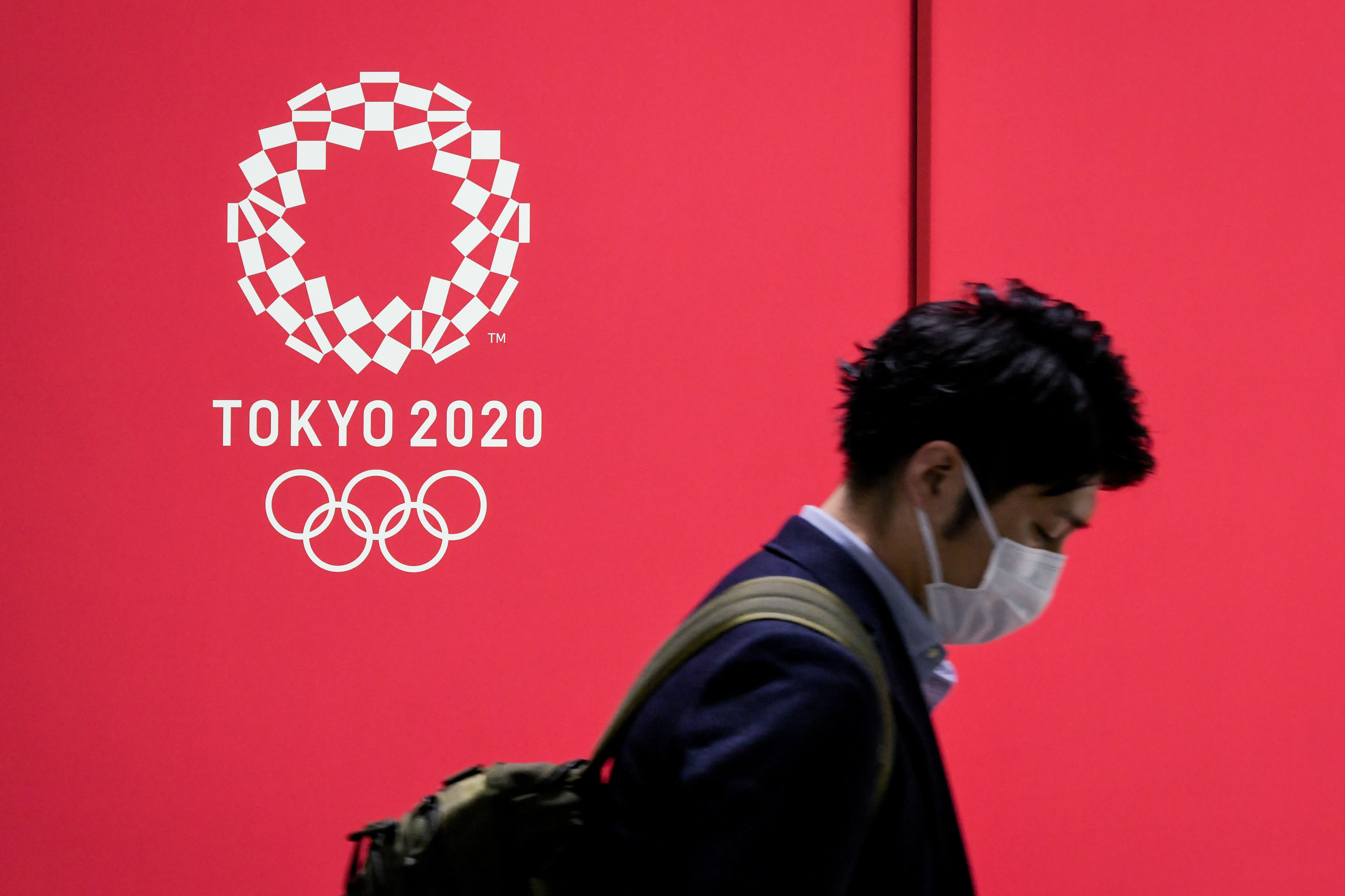 The chief of the Tokyo 2020 organizing committee on Tuesday did not rule out a last-minute cancellation of the Olympics, as more athletes tested posit