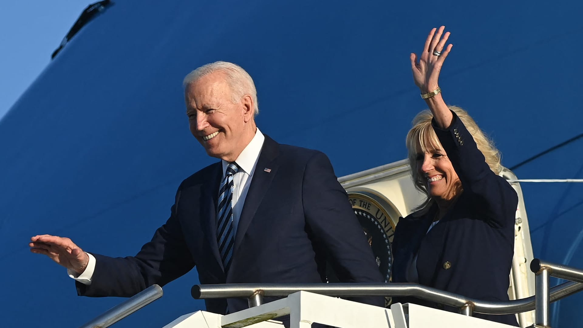 US President Joe Biden (L) and US First Lady Jill Biden disembark from Air Force One on their arrival at Royal Air Force Mildenhall, England on June 9, 2021, ahead of the three-day G-7 Summit.