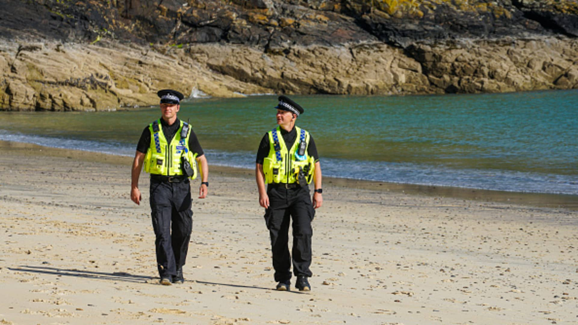Police officers patrol on the beach in front of the Carbis Bay Hotel, host venue for the G7 Summit conferences, on June 03, 2021 in Carbis Bay, Cornwall.