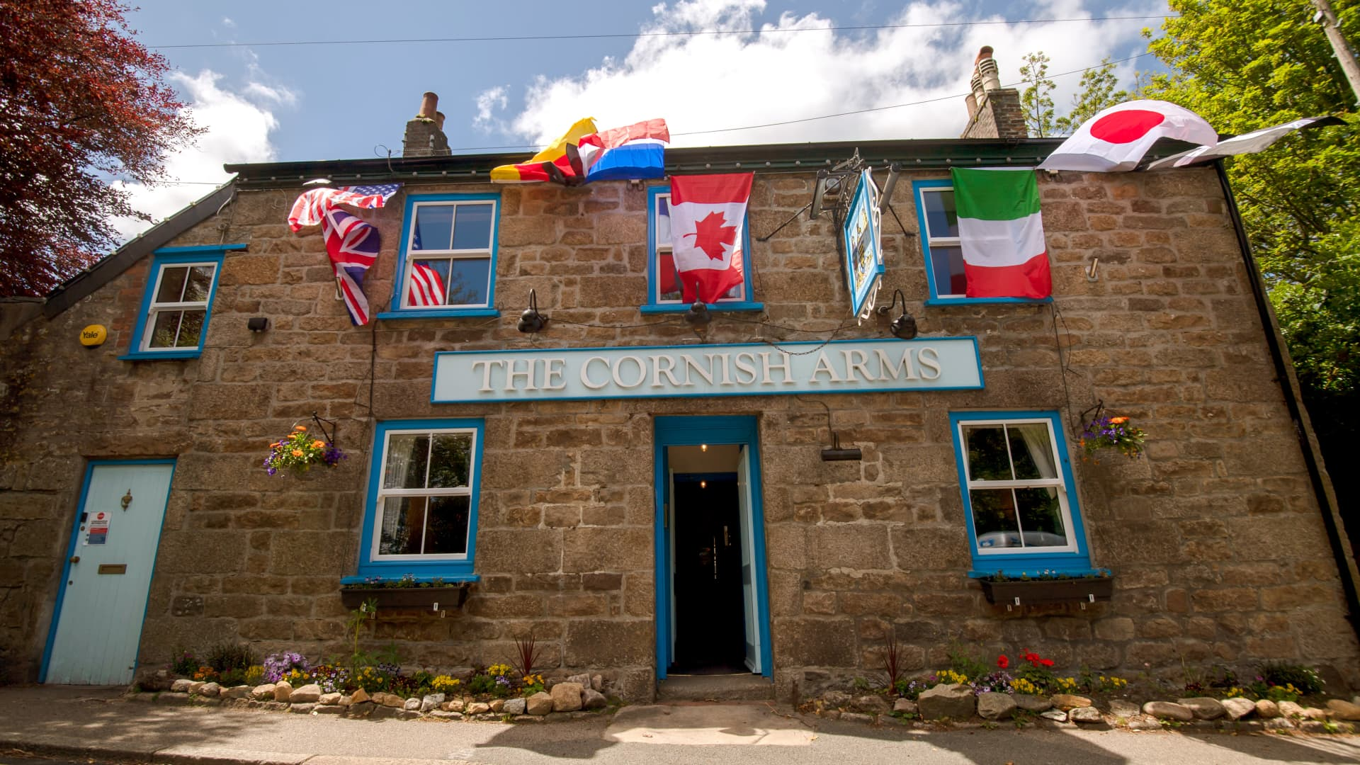 The Cornish Arms public house decorated with the flags of the G-7 countries near the venue for the upcoming Group of Seven leaders summit.