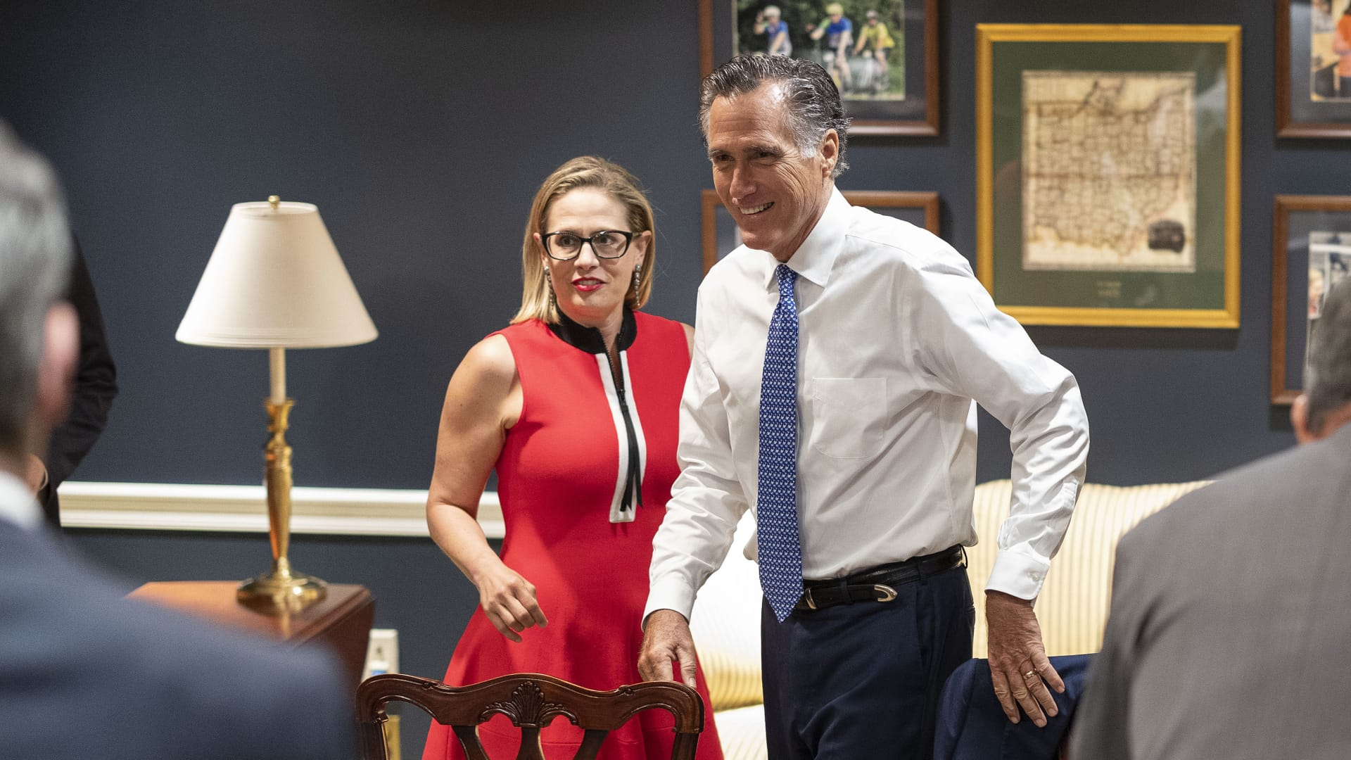 U.S. Sens. Kyrsten Sinema (D-AZ) (L) and Mitt Romney (R-UT) arrive for a bipartisan meeting on infrastructure after original talks fell through with the White House on June 08, 2021 in Washington, DC.