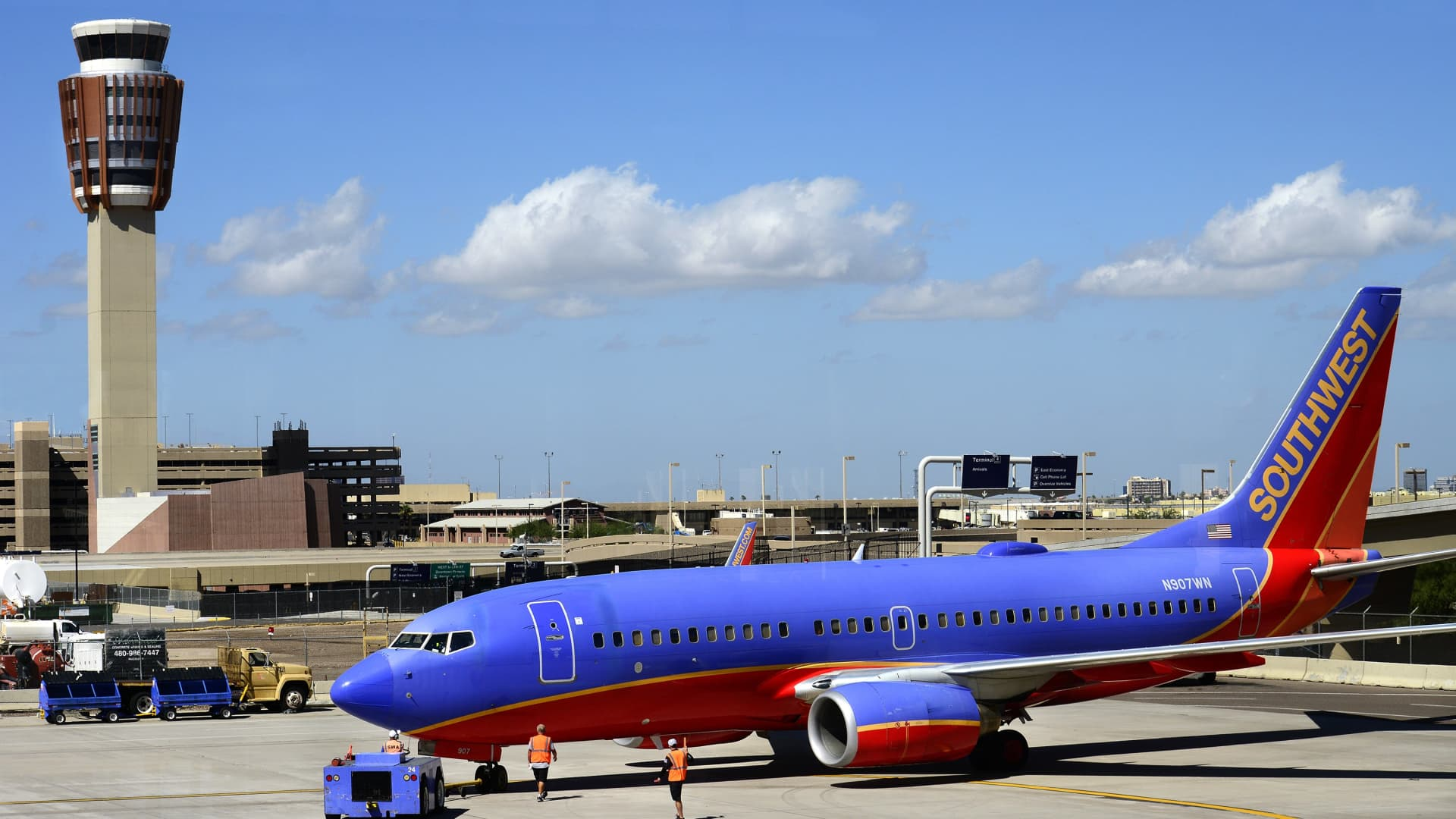 A Southwest Airlines Boeing 737 passenger aircraft is towed on the tarmac at Phoenix Sky Harbor International Airport in Phoenix, Arizona.