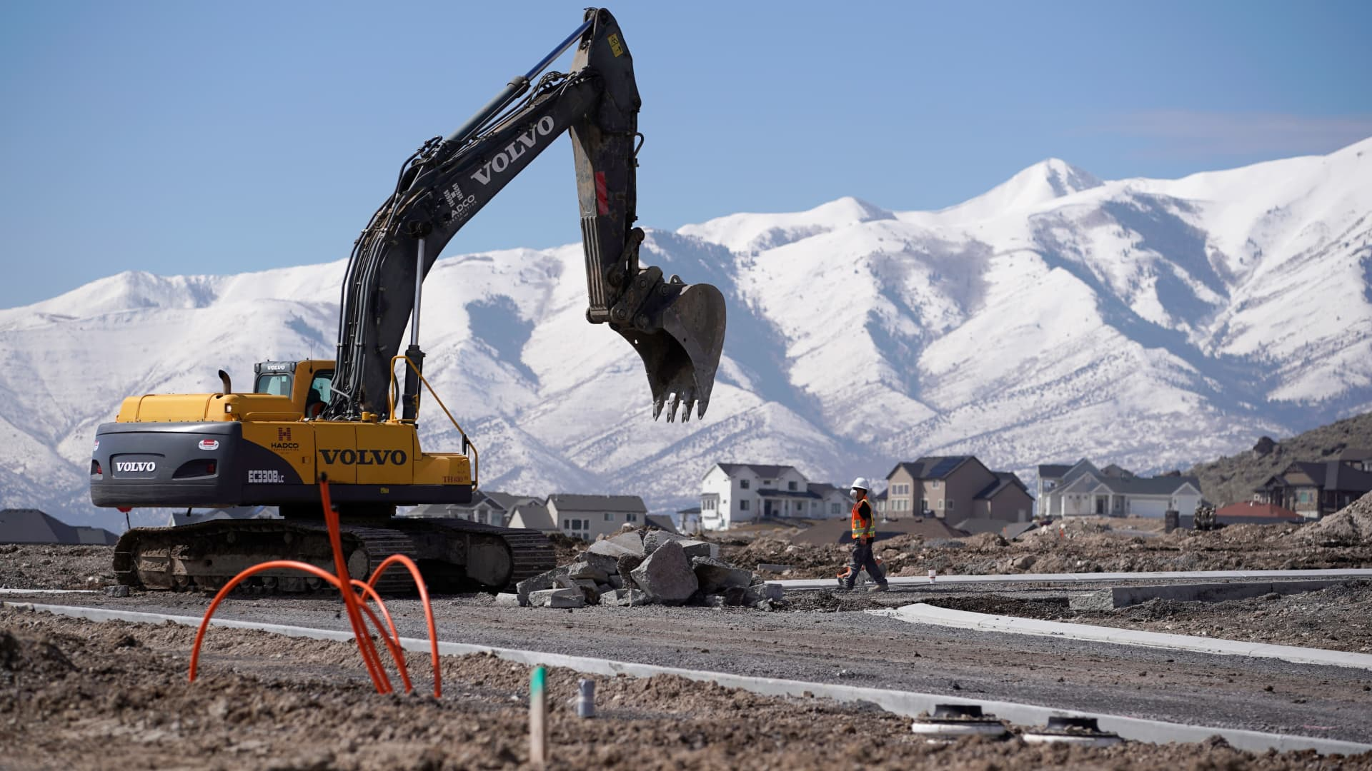 A worker uses a Volvo AB excavator to build a road during construction in Saratoga Springs, Utah.