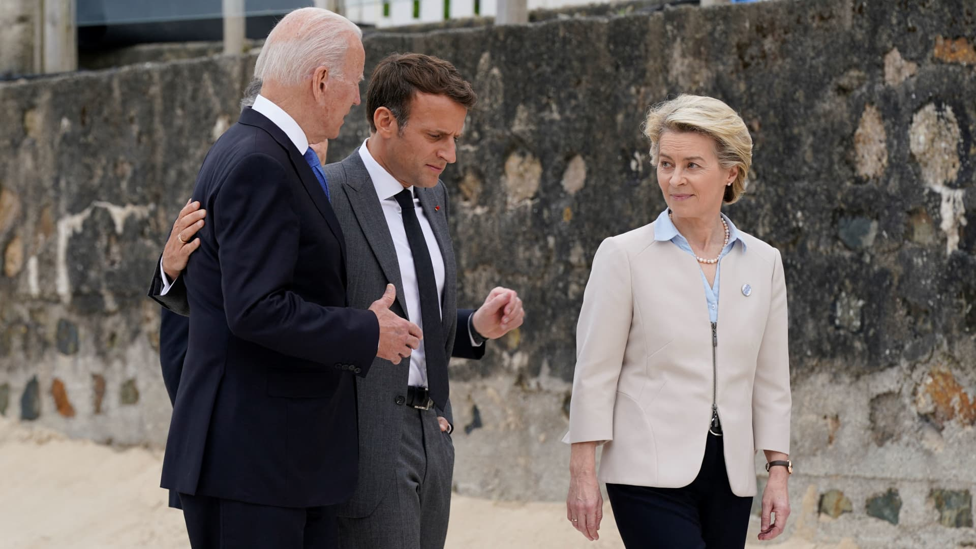 US President Joe Biden (L) and France's President Emmanuel Macron (C) talk with President of the European Commission Ursula von der Leyen after the family photo at the start of the G7 summit in Carbis Bay, Cornwall on June 11, 2021.