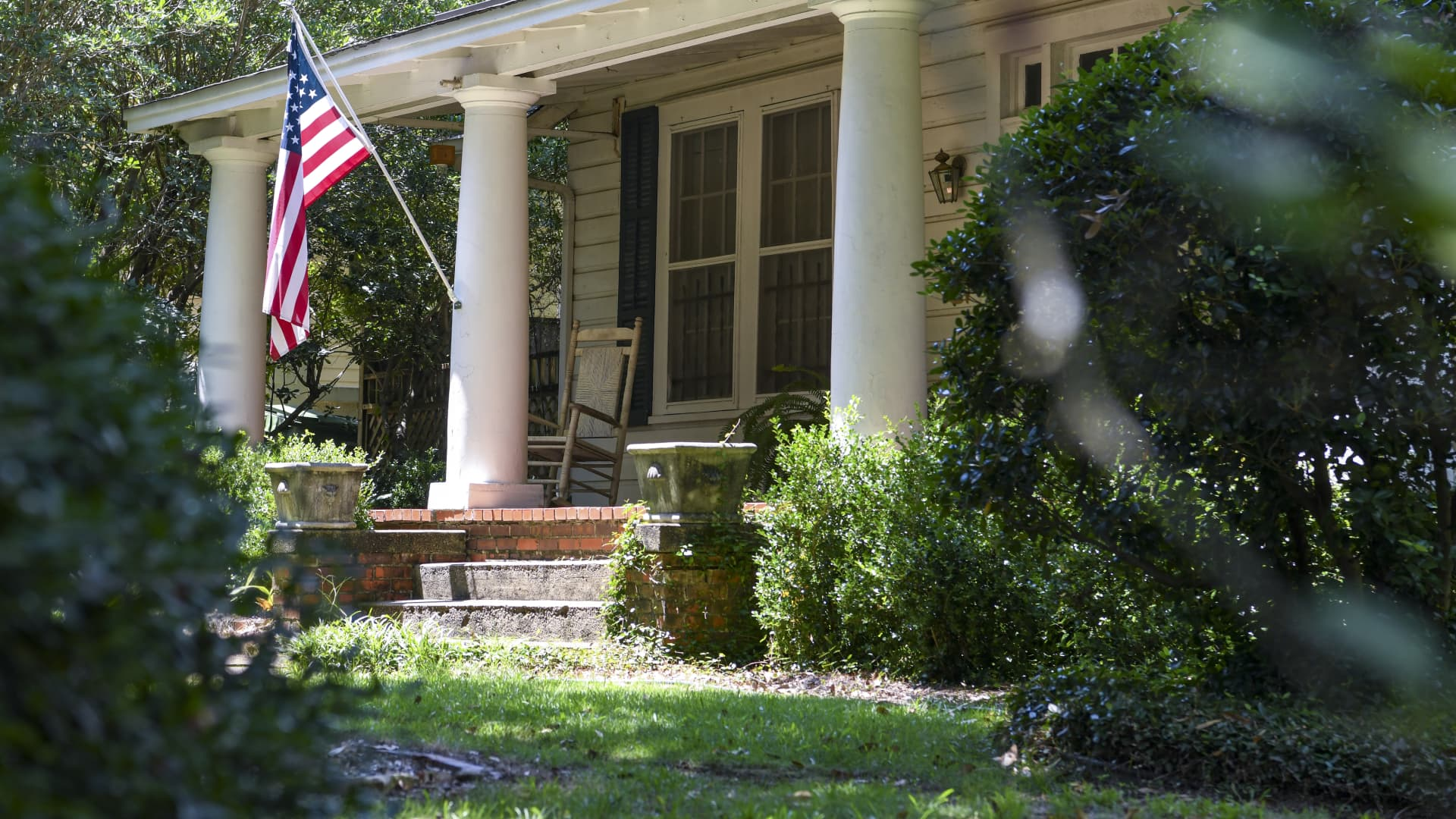 An American flag is displayed outside a home in the Cloverdale neighborhood of Montgomery, Alabama.