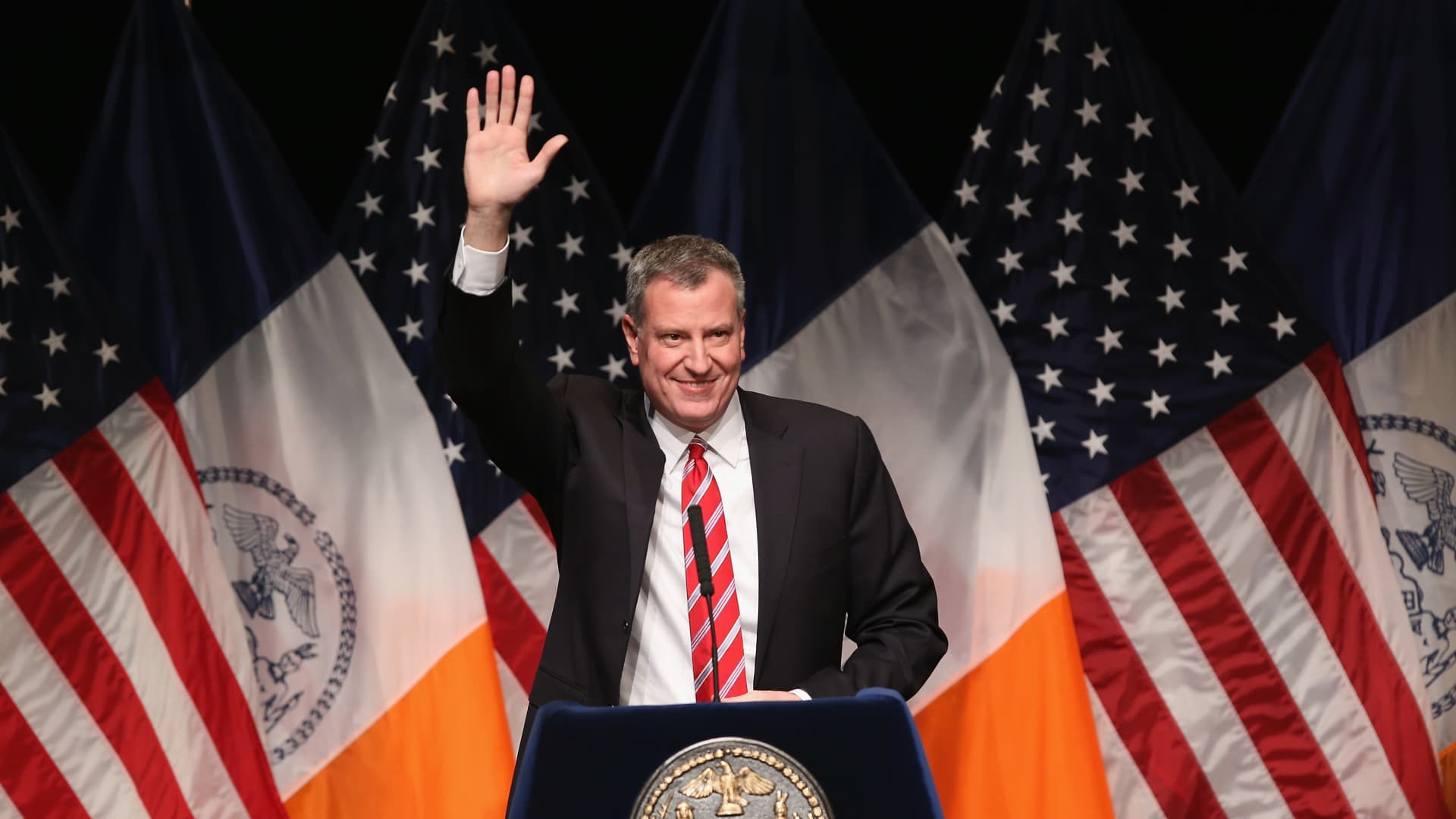 New York City Mayor Bill de Blasio waves as he gives the State of the City address at La Guardia Community College on February 10, 2014 in the Long Island City section of the Queens borough of New York City.