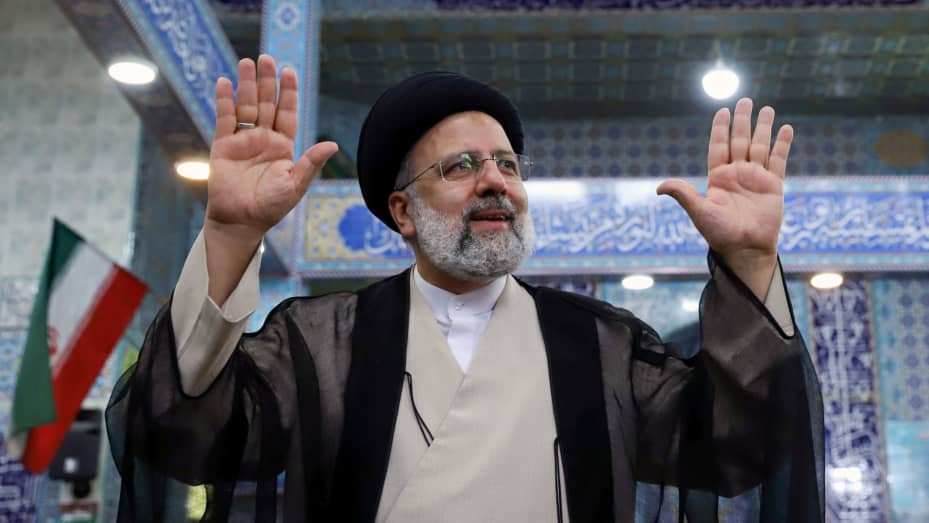 Presidential candidate Ebrahim Raisi gestures after casting his vote during presidential elections at a polling station in Tehran, Iran June 18, 2021.