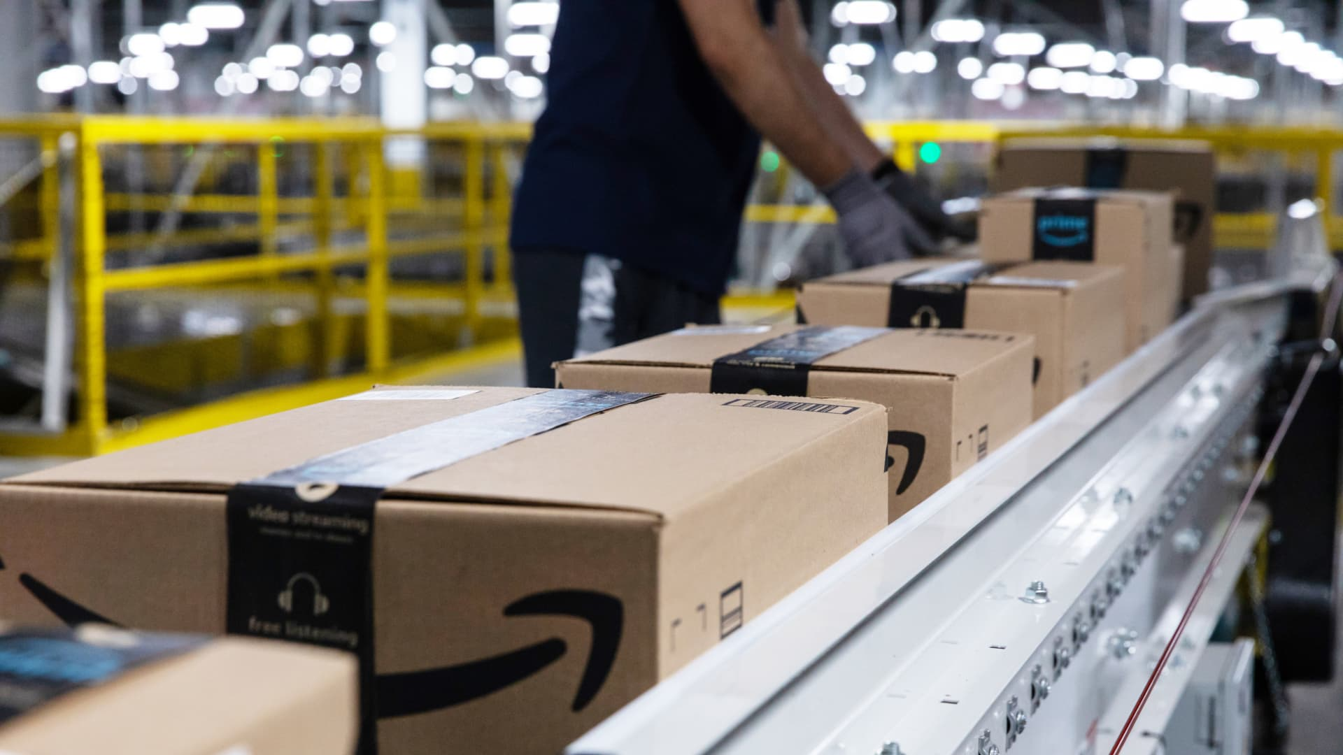 Boxes move along a conveyor belt at an Amazon fulfillment center on Prime Day in Raleigh, North Carolina, U.S., on Monday, June 21, 2021.