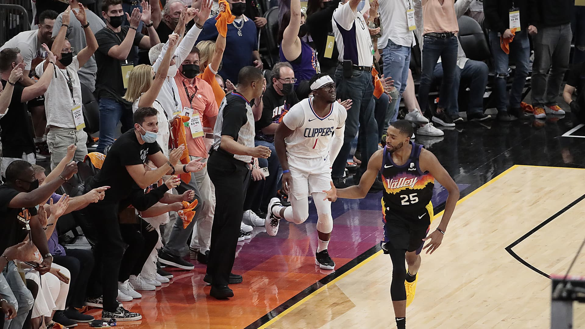 Fans erupt after Phoenix Suns forward Mikal Bridges (25) hit a three-pointer over LA Clippers guard Reggie Jackson (1) late in Game one of the NBA Western Conference Finals at Phoenix Suns Arena.