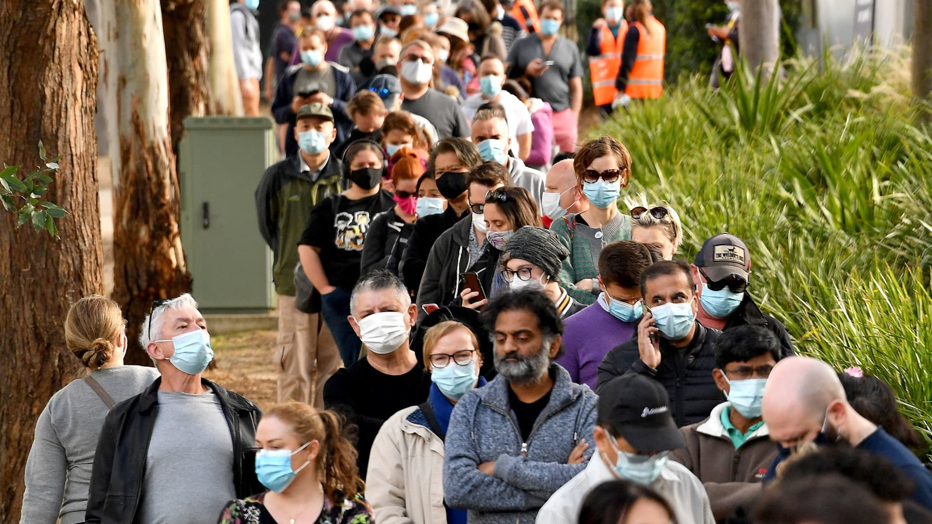 People queue outside a vaccination center in Sydney on June 24, 2021, as residents were largely banned from leaving the city to stop a growing outbreak of the highly contagious Delta Covid-19 variant spreading to other regions.